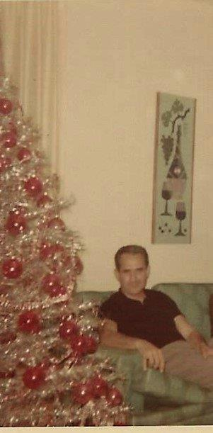 Uncle Vince, 1967 in his home beside his beautiful white Christmas tree.