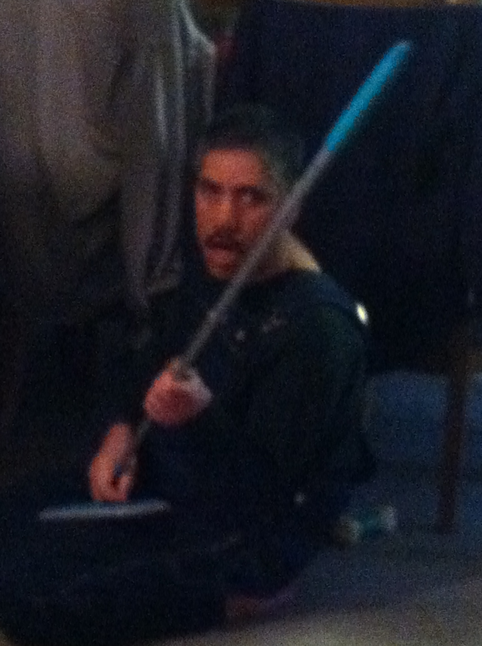 with broom in hand and acting like a jedi