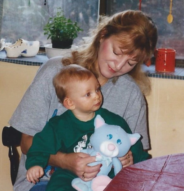 Sheila with Ricky at my mom's house in Weymouth. Ricky is holding Sleep Kitty which Sheila nd Nancy gave to Ricky and he still has it today.