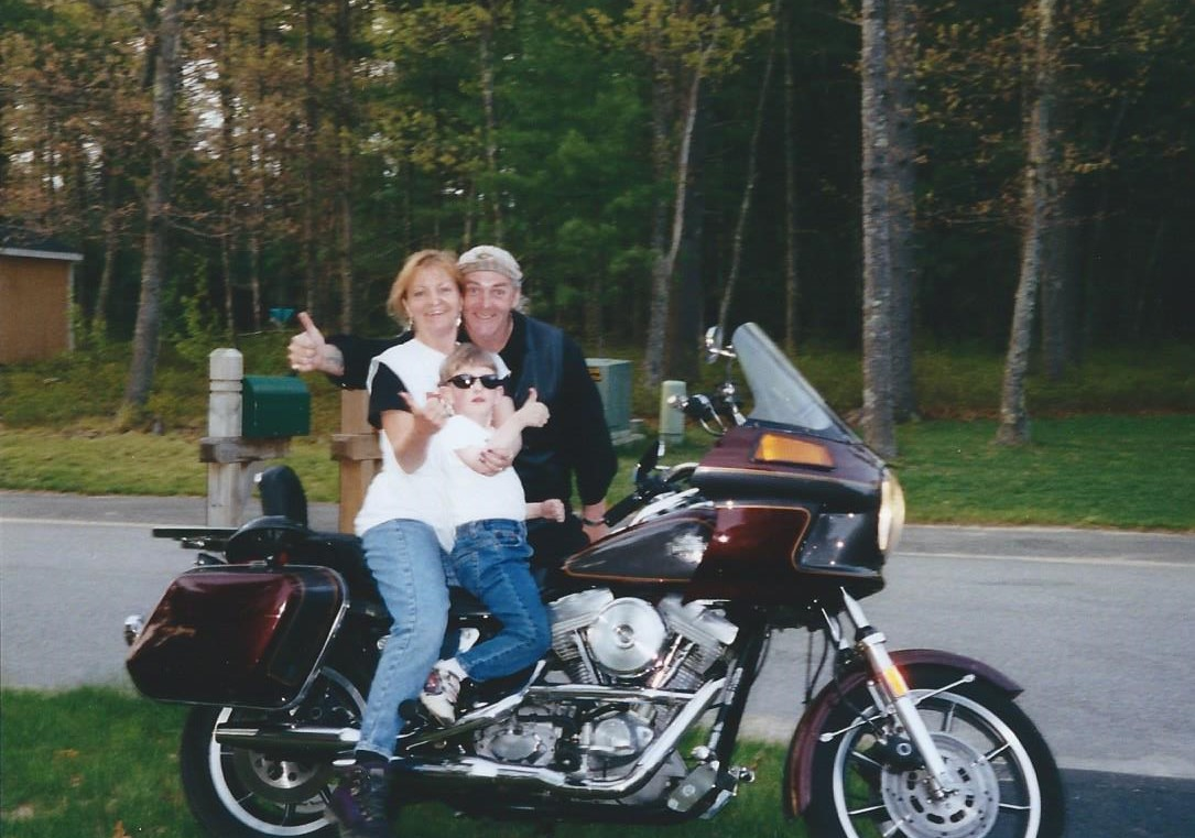Sheila with Charles and Ricky at my home. Sheila loved motorcycles and was so proud to get her Motorcycle License.