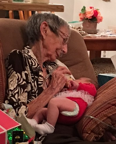 Feeding her newest great-granddaughter Audrey