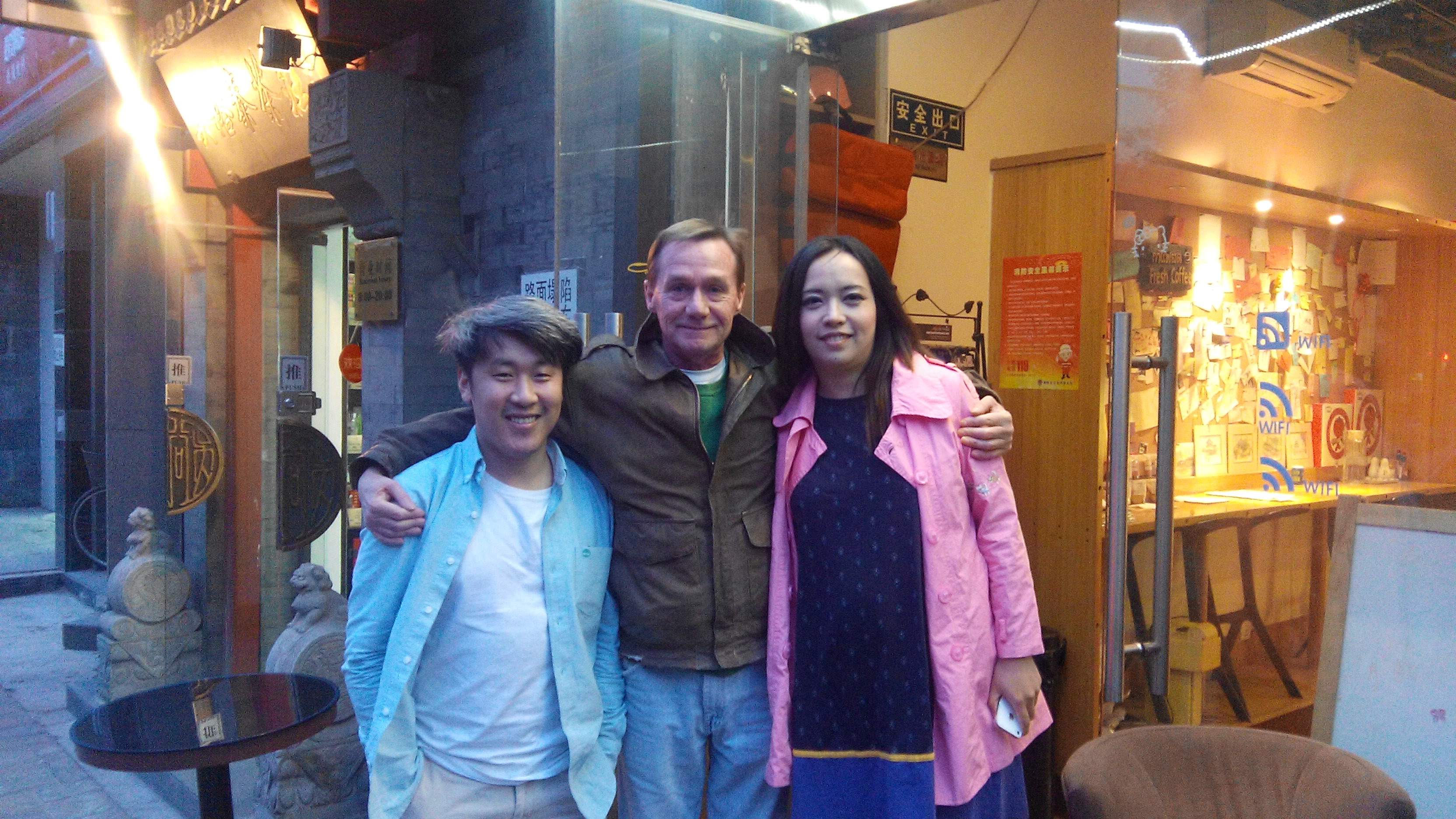 Denis with Lisa and Ethan in front of Tomato cafe in Beijing.