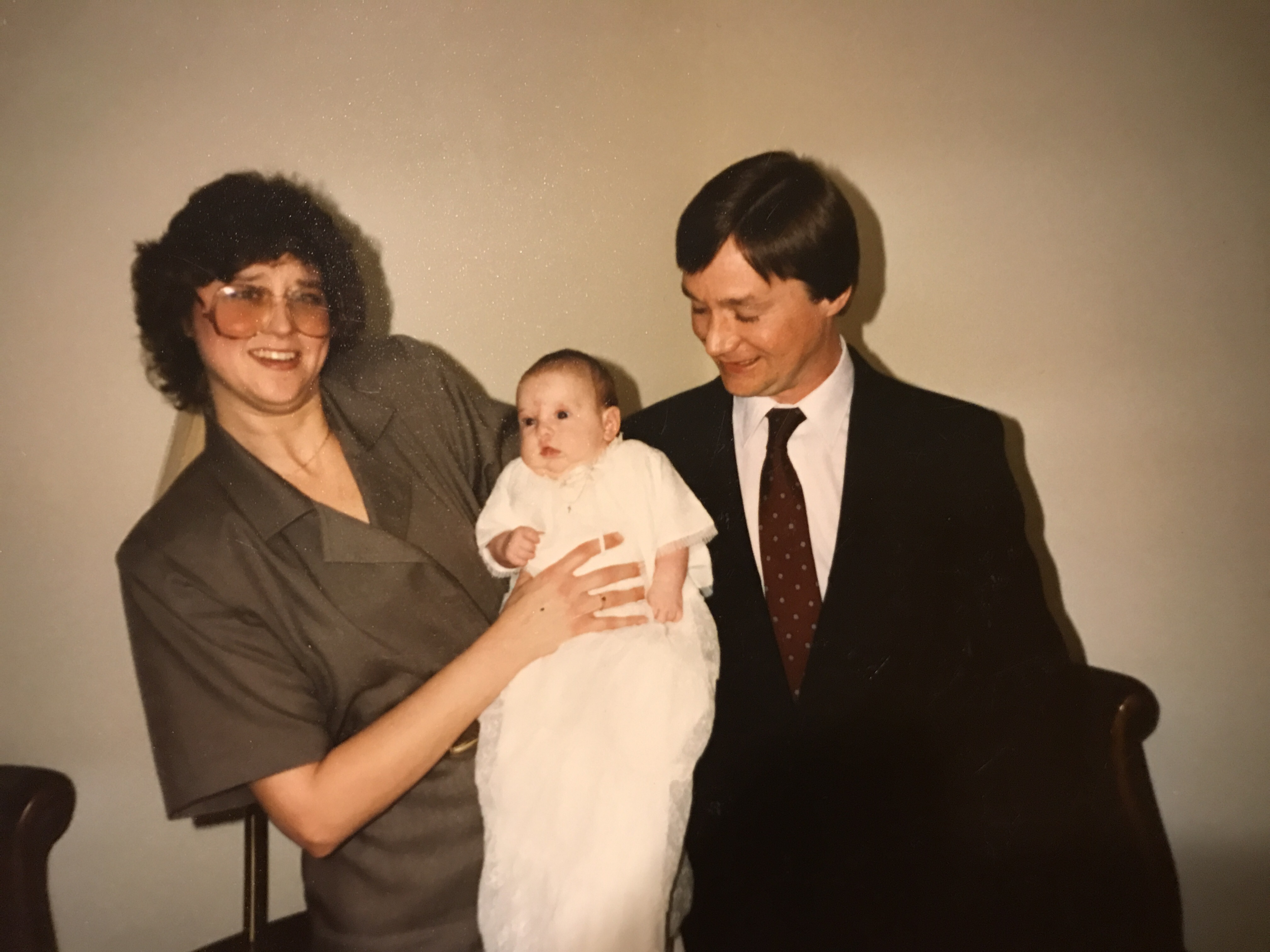 A great photo from my baptism with my godparents. I love how Denis is looking lovingly at me.