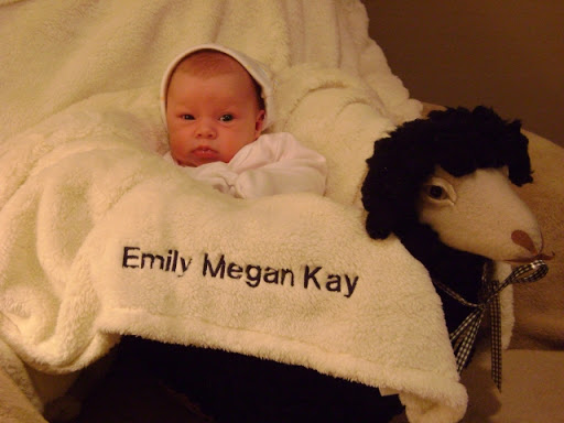 This is Emily with a blanket and basket Kay gave her. We still love both!