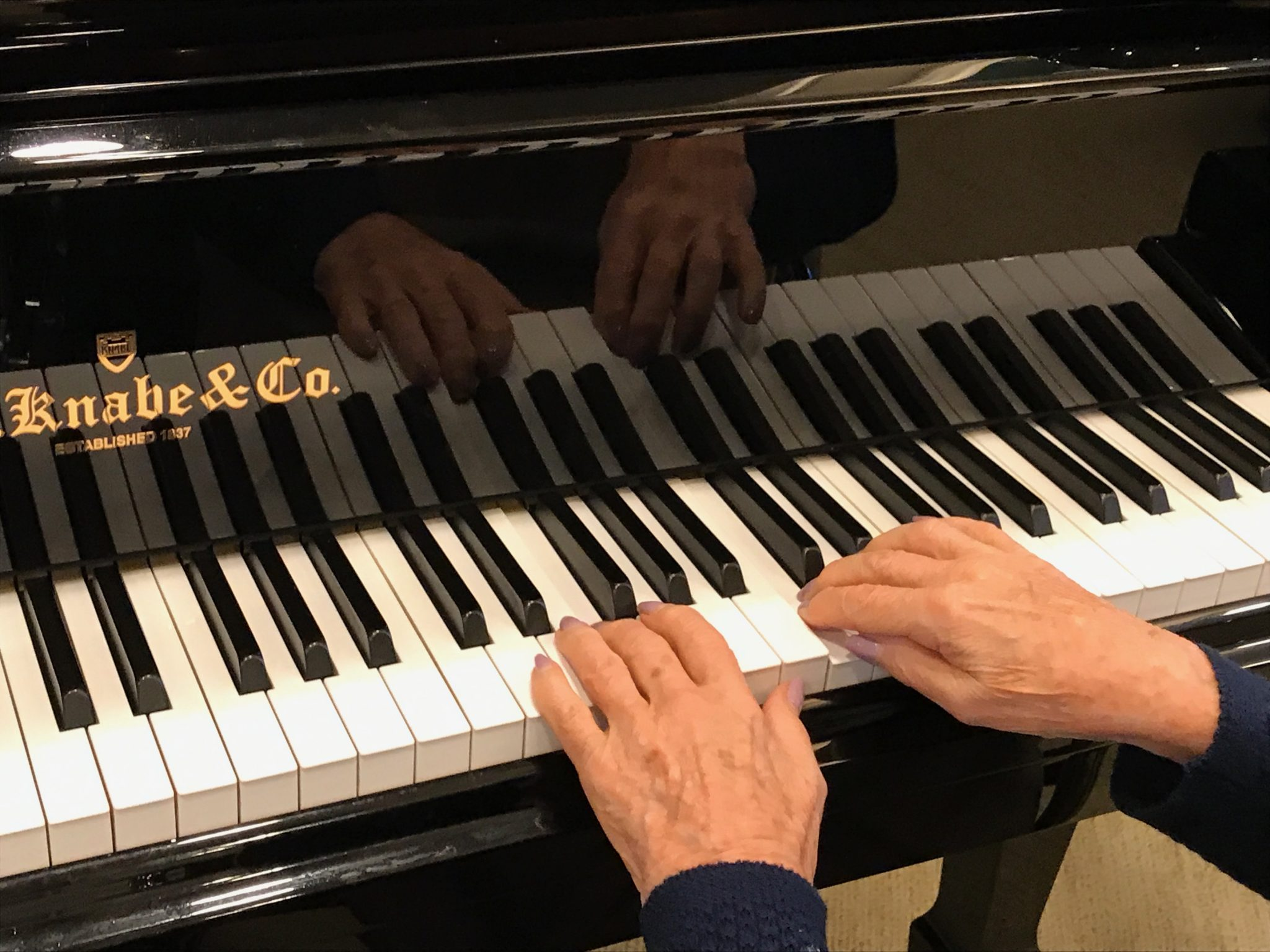 Always tickling the ivories. Her music & love with live on in our hearts
