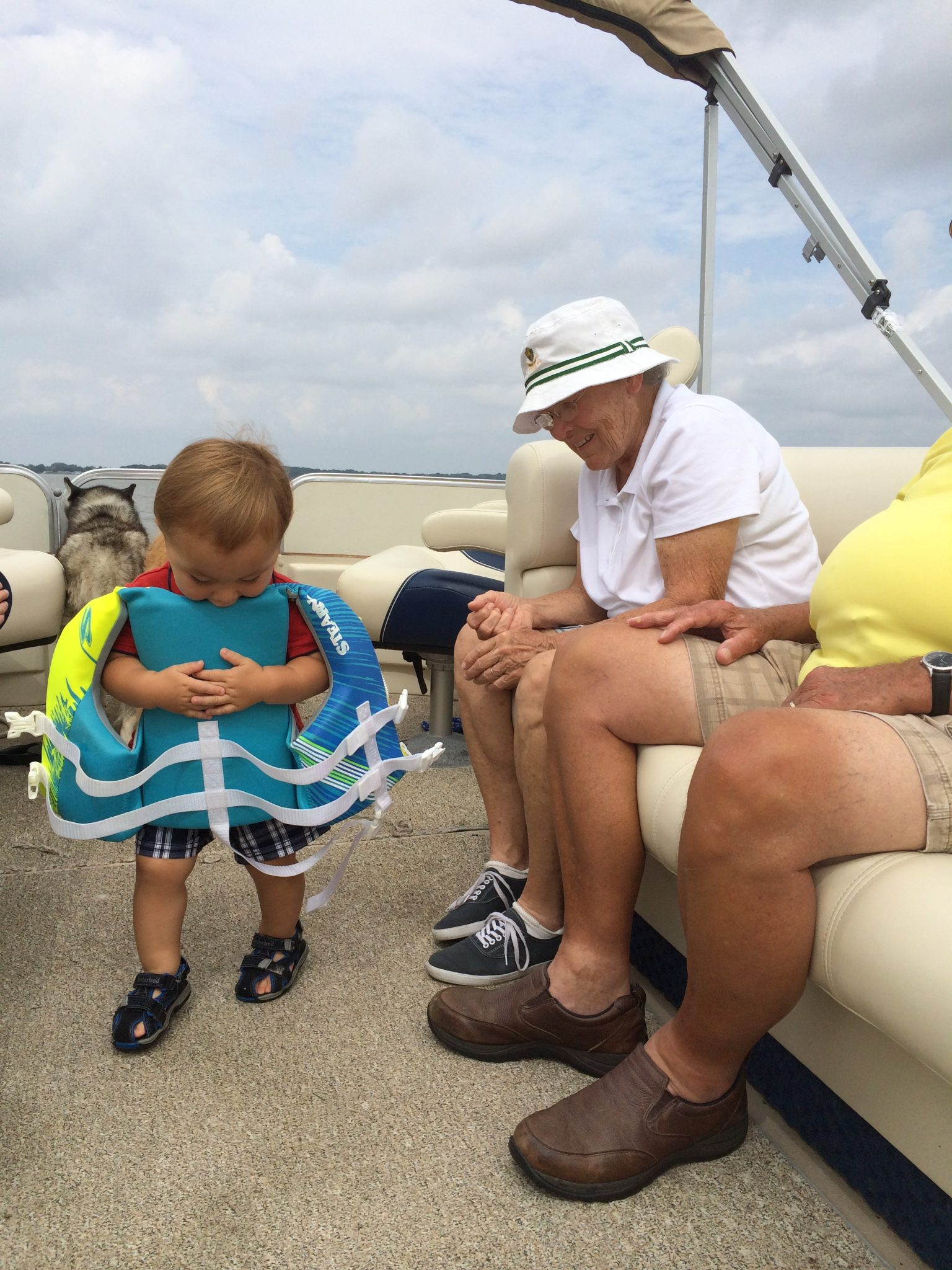 Grandma boating with the family.