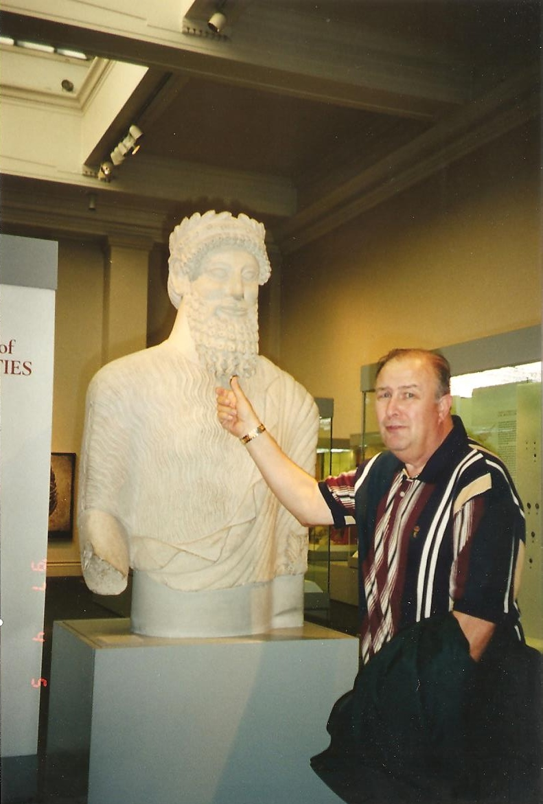 Daddy tweaking the beard of some ancient ruler's statue in the British Museum. He loved nothing better than teasing people or playing some kind of prank, all the way from a fellow co-worker right up to a king.