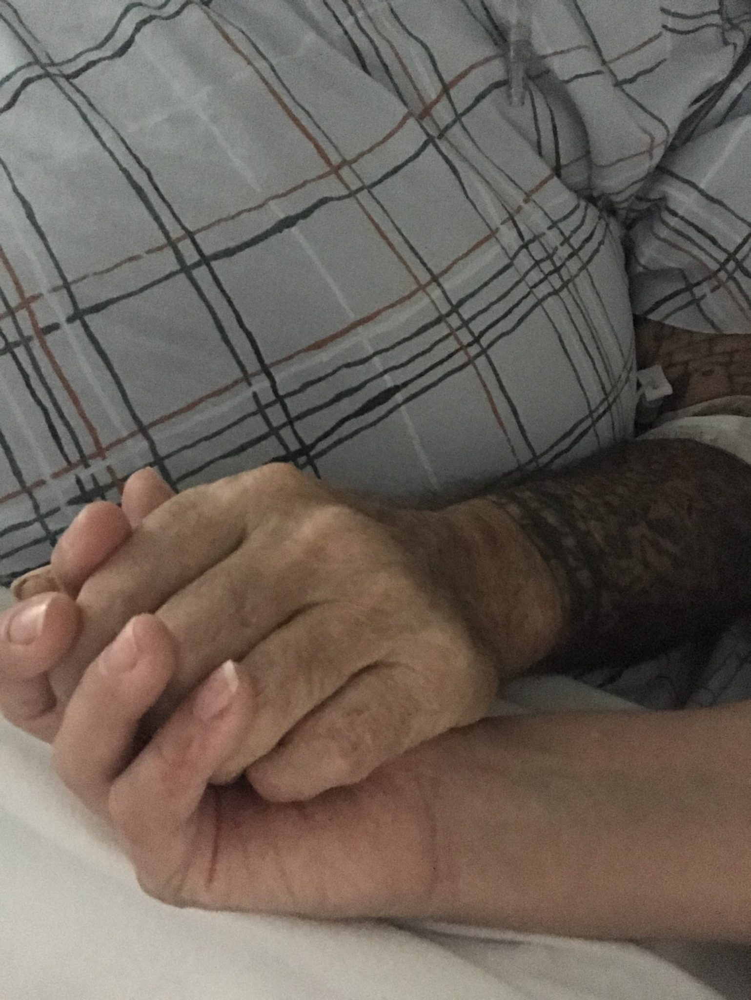 Holding Deans hand in Hospice