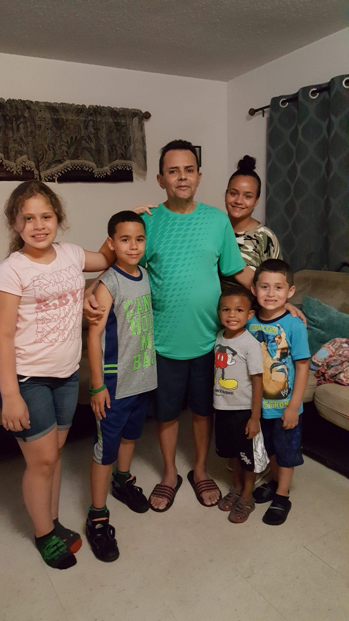 Raul Vargas with his five grandchildren