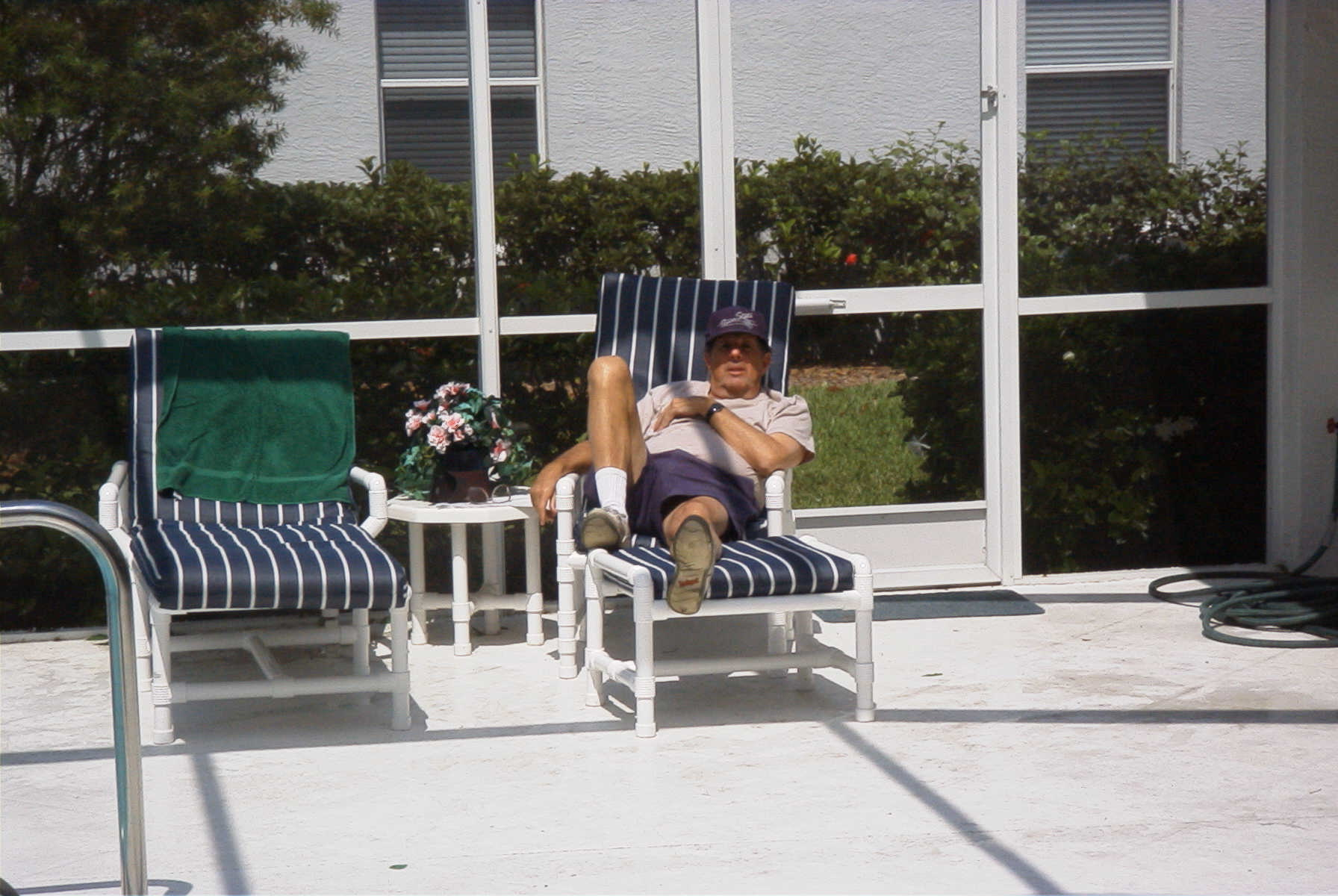 Joel relaxing by the pool. I miss him so much.