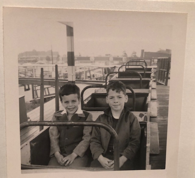 Howard, at age 7, and me (cousin Jay) share a roller coaster. He is the happy one. It seemed that he was always happy.
