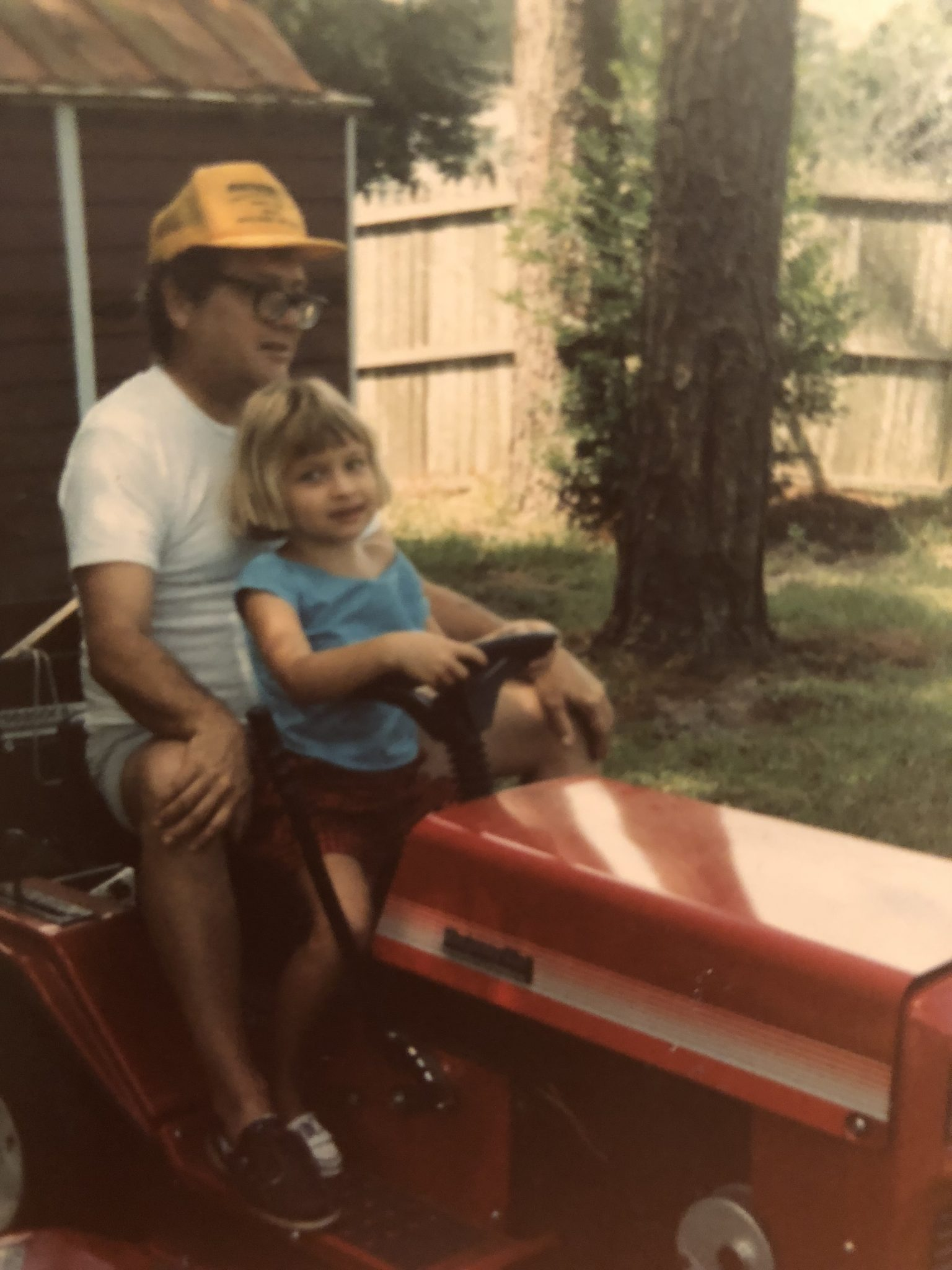 My dad and I riding our beloved lawnmower.