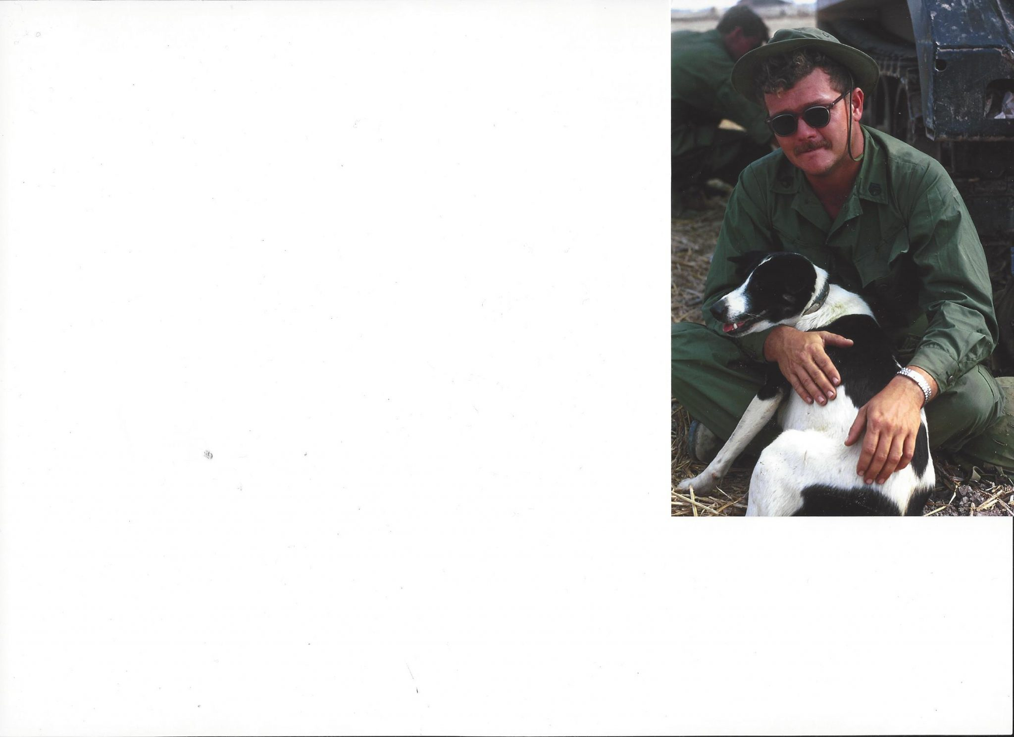 Nelson and a dog in Vietnam.