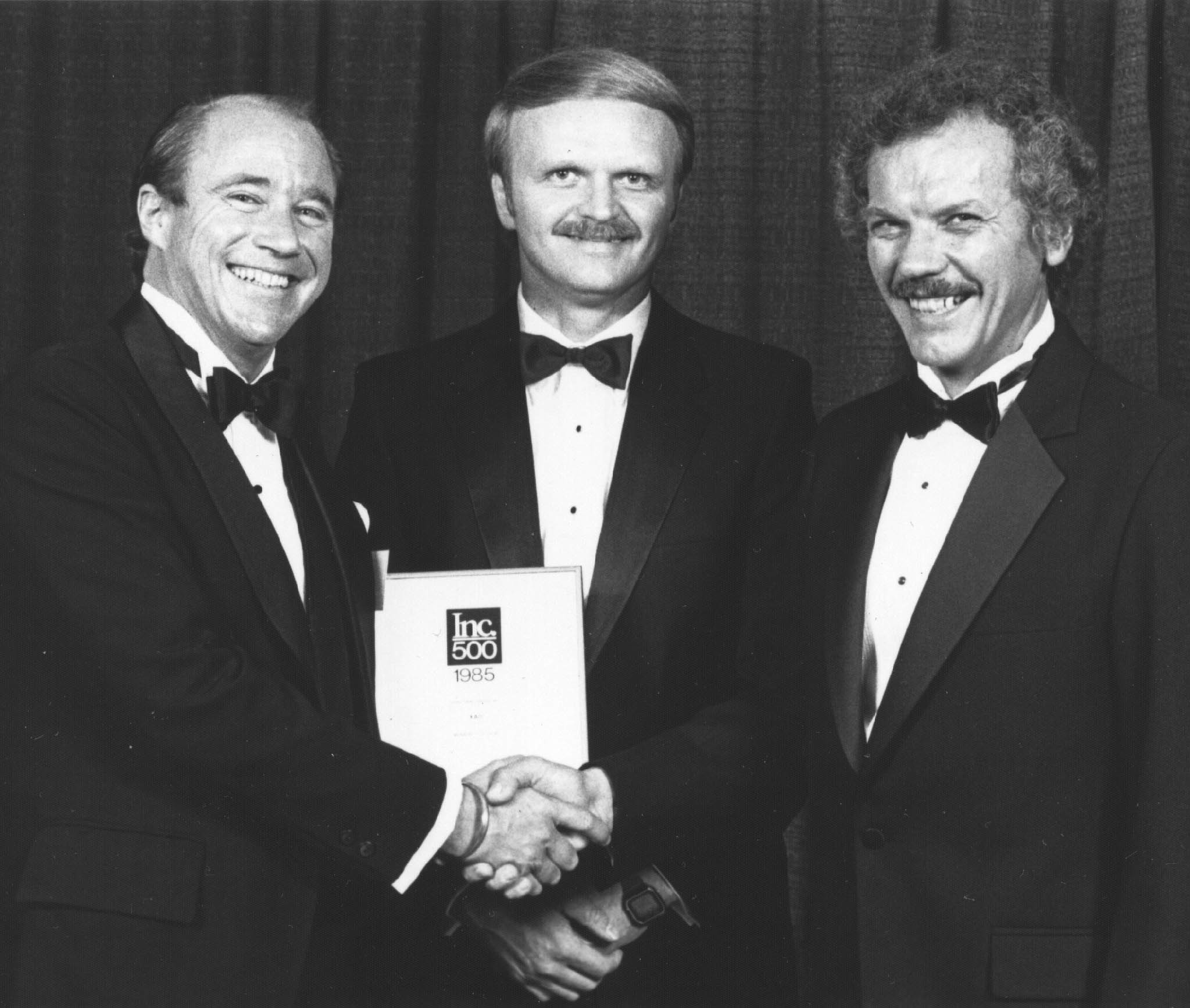 Bob and Heinz accepting the INC 500 award, 1986