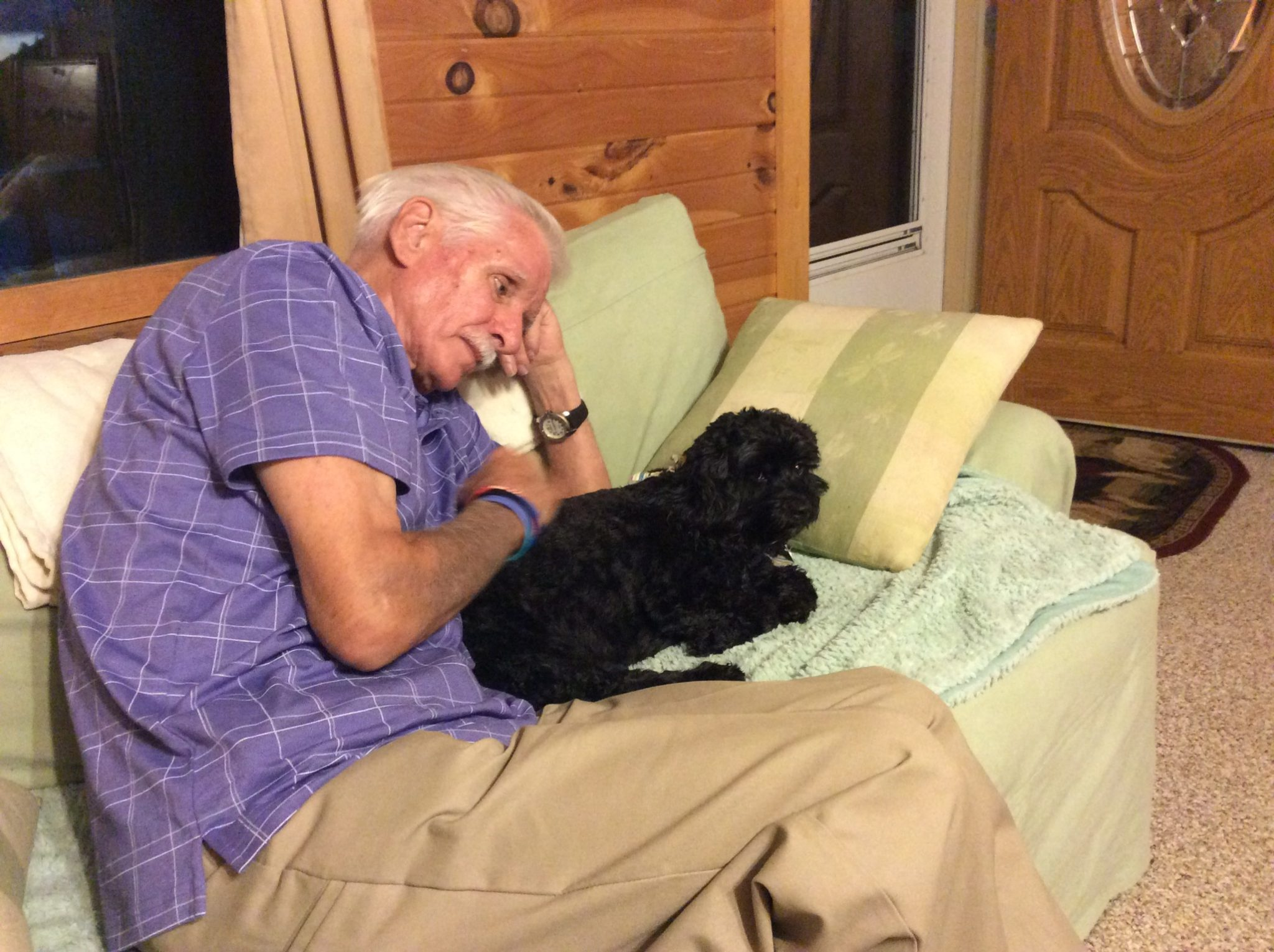 We are so grateful that Val and Bill were able to visit us last summer. This photo of him with our cockerpoo Holly captures his sweet soul so well. We will miss him so much. Our deepest condolences go out to Val and the whole family.
