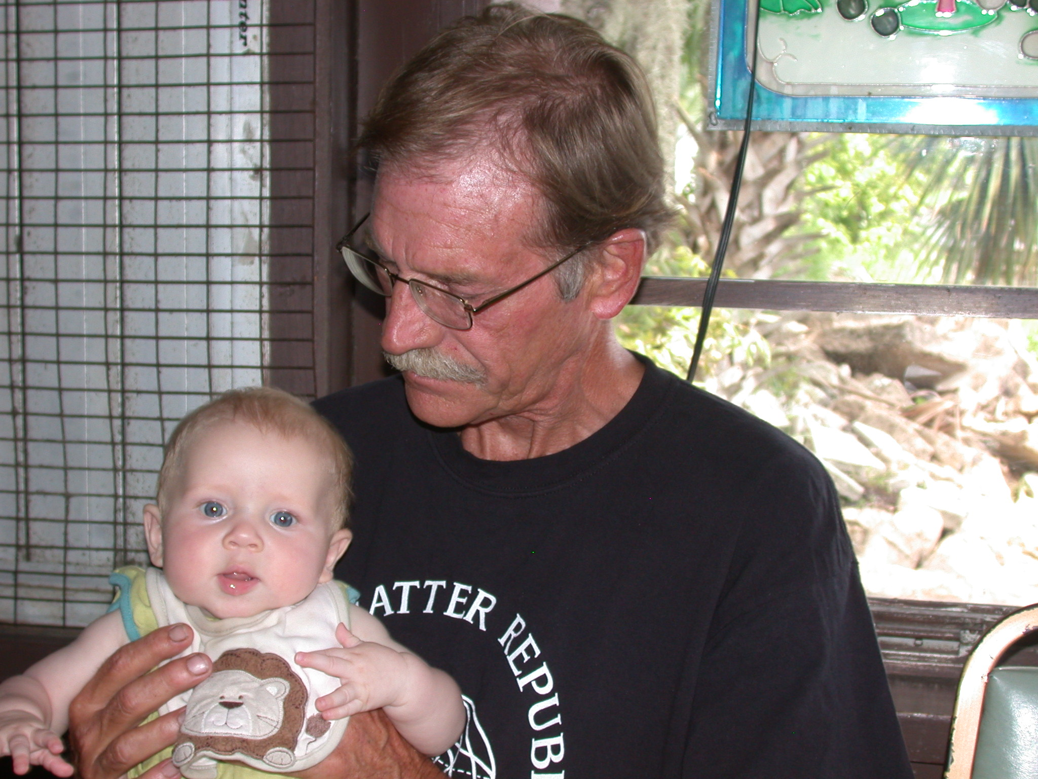 Larry, holding his first grandchild. We will miss you.