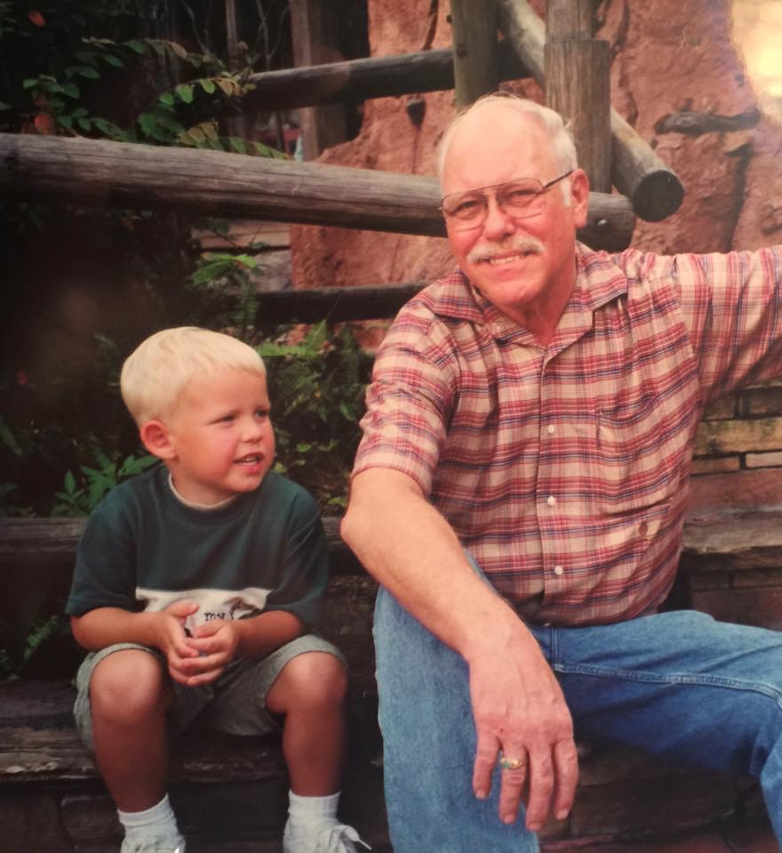 My grandfather and I sitting down at Magic Kingdom. Miss him very much.