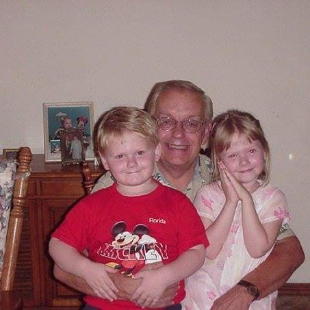 Greg with his two grand children