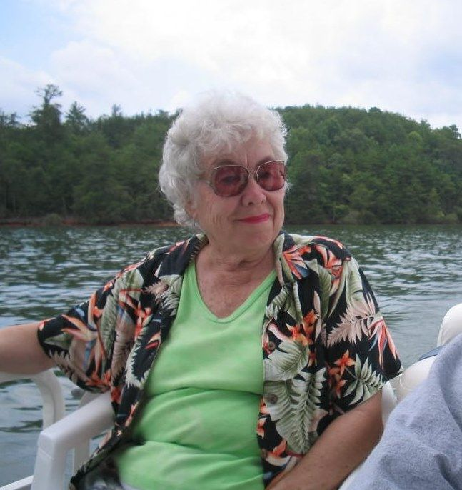 My mom will be dearly missed.  She was always happy when near the water, and she loved the mountains of North Carolina, so here's a photo of her enjoying both at Lake Lure.  Peace for you and your spirit, Mom.