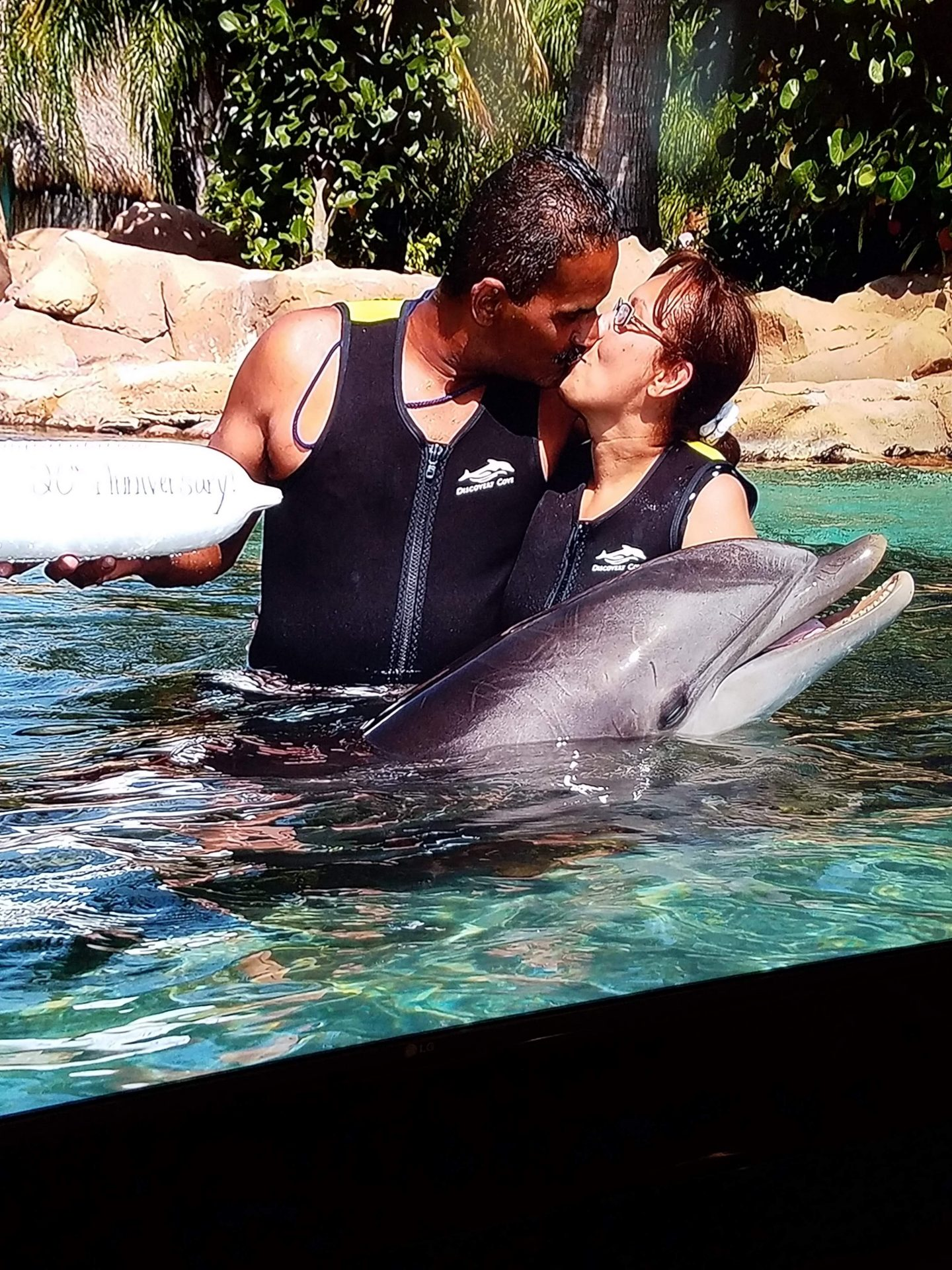 Our 20th Anniversary. We had so much fun at Discovery Cove. I could not swim, you kept holding me up. Love you, God please take care of my husband.