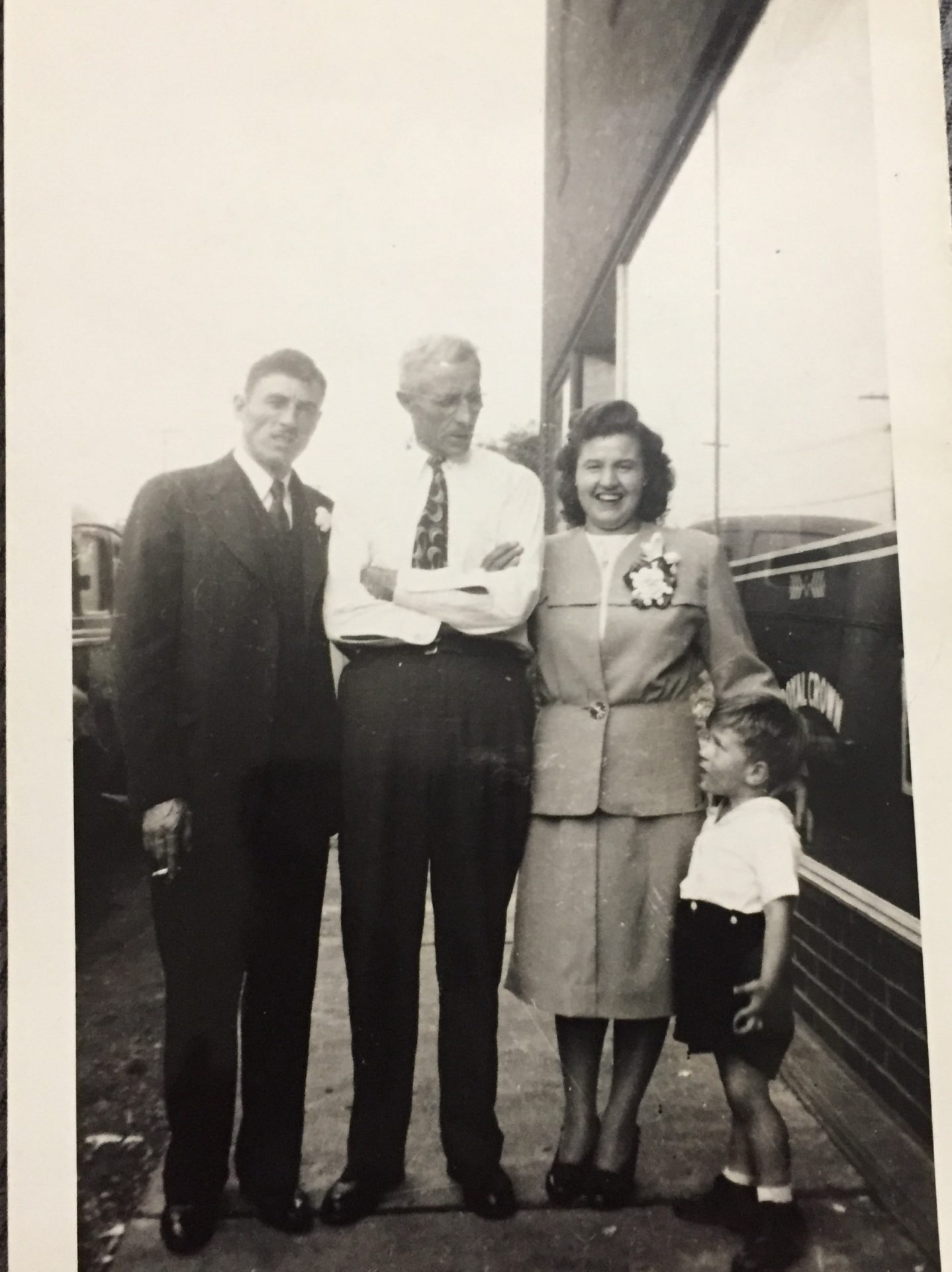 My parents on their wedding day with my grandfather. The little guy is Uncle Livio ??