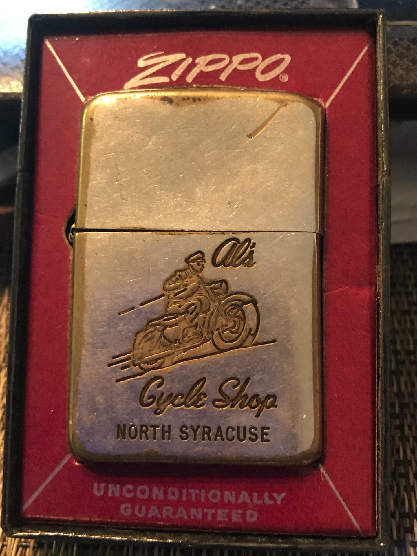 Al's Cycle Shop lighter . Danny's Dads lighter my Aunt Billie Gave me