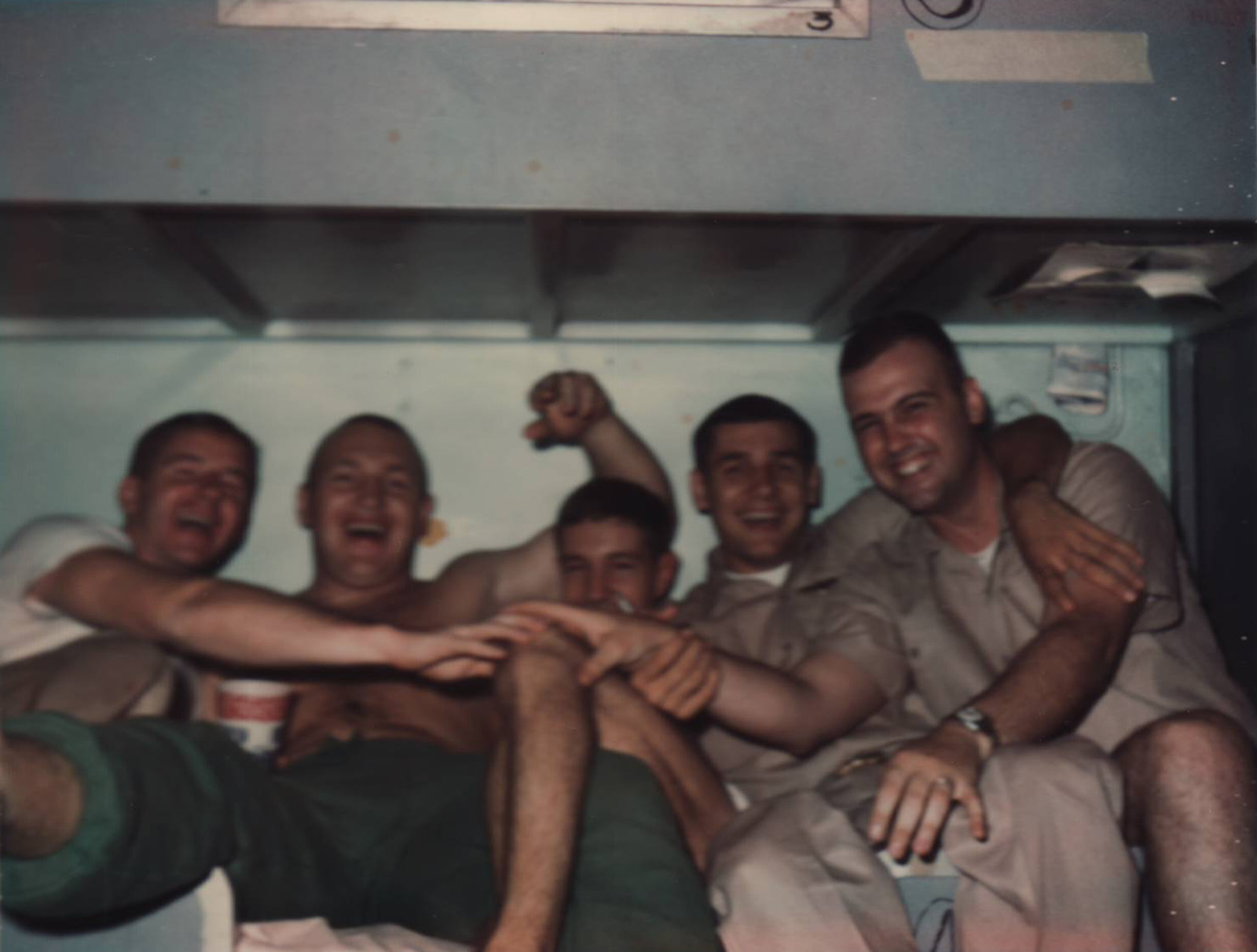 Paul in center with Rich Keenan and Vern Von Sydow to his right; and Rick Grant and Ollie Donelan to his left. The picture was taken aboard the USS Kearsarge during Paul's 1966 deployment flying search and rescue missions in Vietnam.