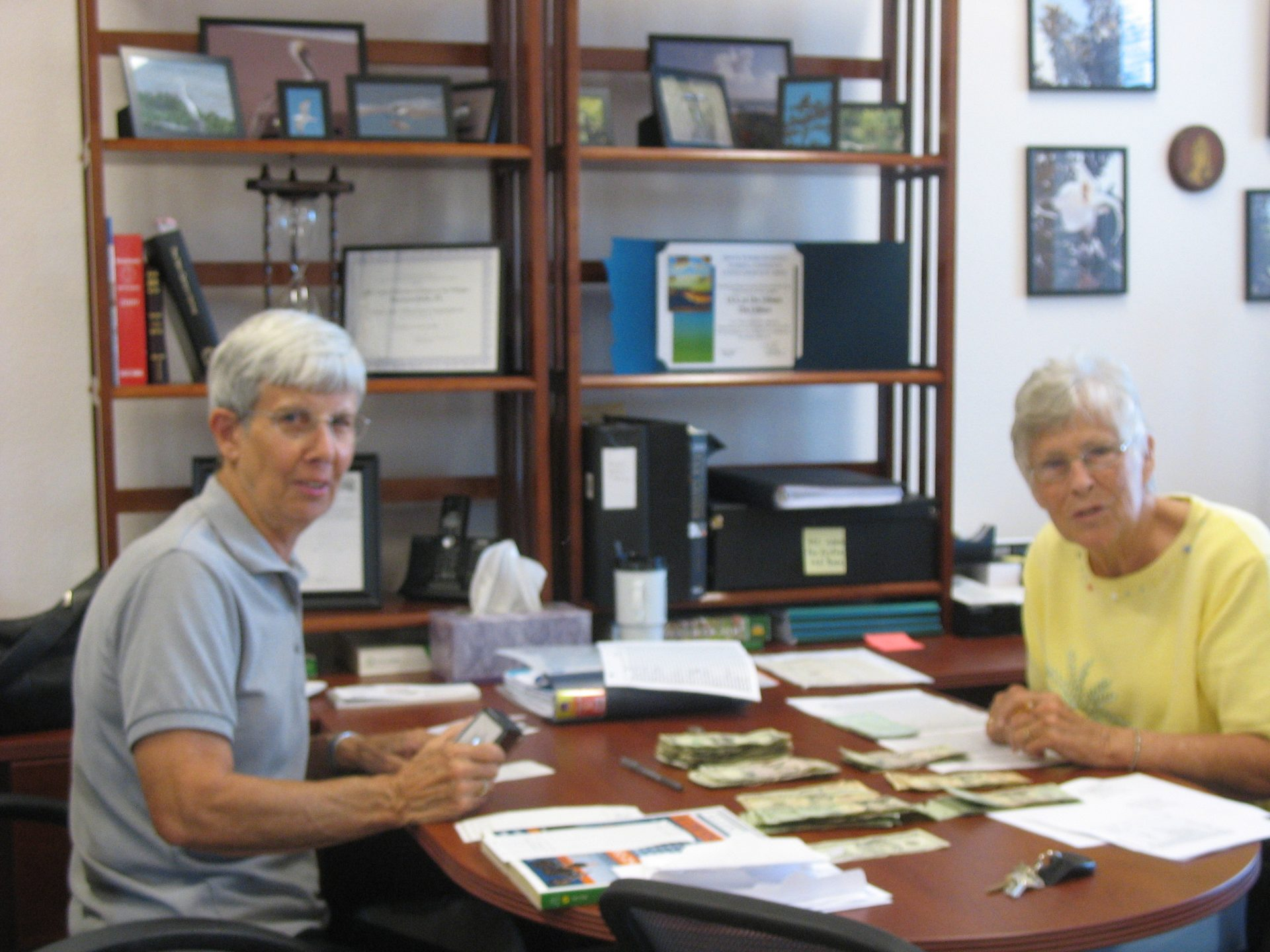 Pat and Nancy working in the church office