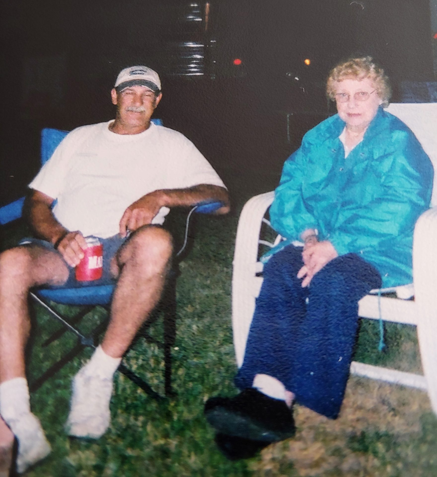 Bob and his mom, Mary Cartino by the camp fire