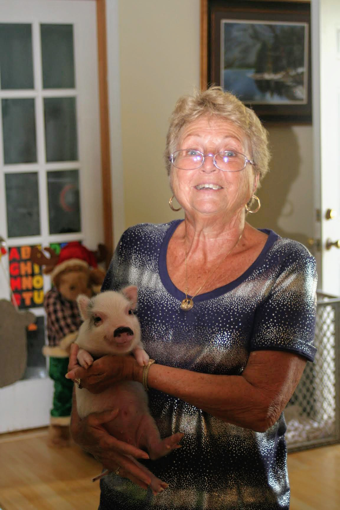Mom holding a little piggy