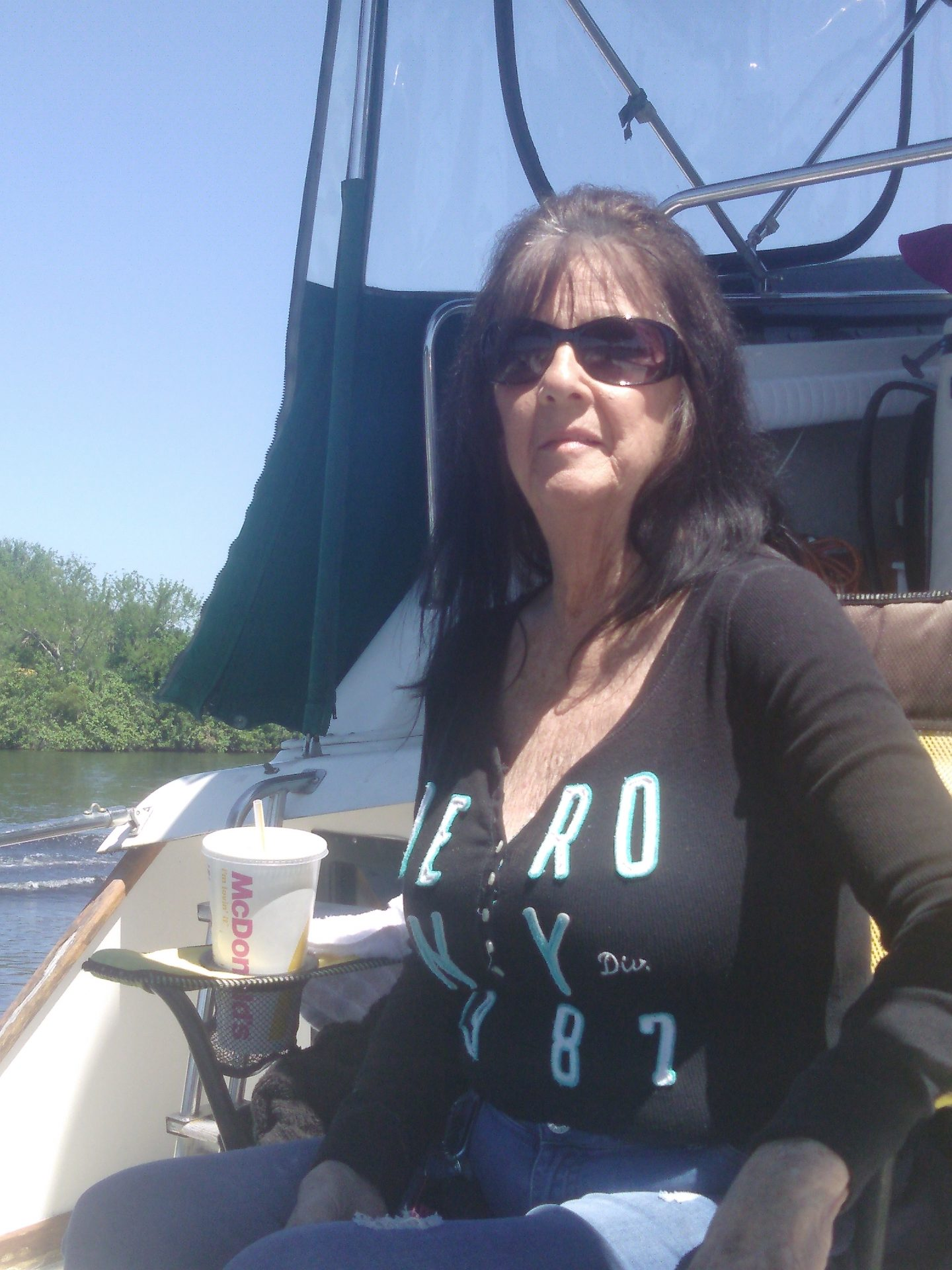 Mom enjoying a boat ride with me.