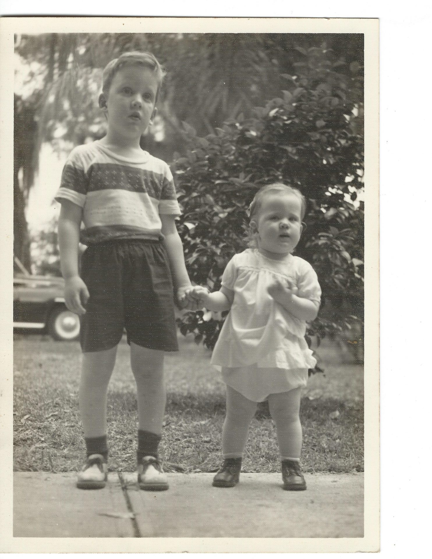 Victor and Valorie in grandmothers front yard in 1956 or so. Mother liked this picture.