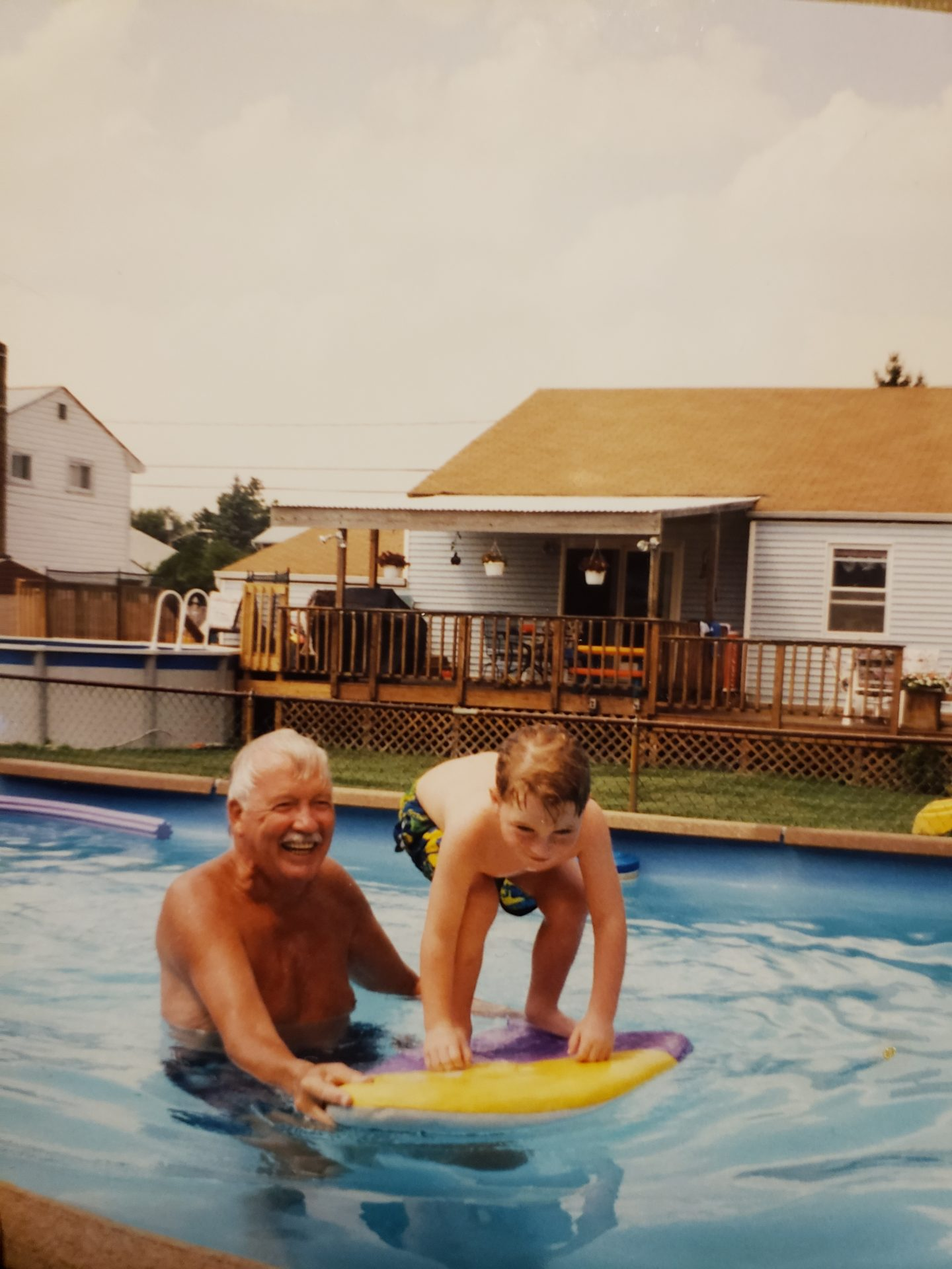 Trying to teach Patrick how to surf, In a pool.