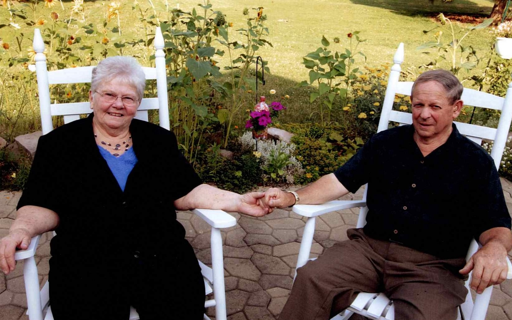 Neil and Elizabeth Sitting together in the garden