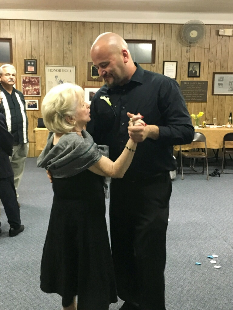 A wedding dance with her oldest grandson.