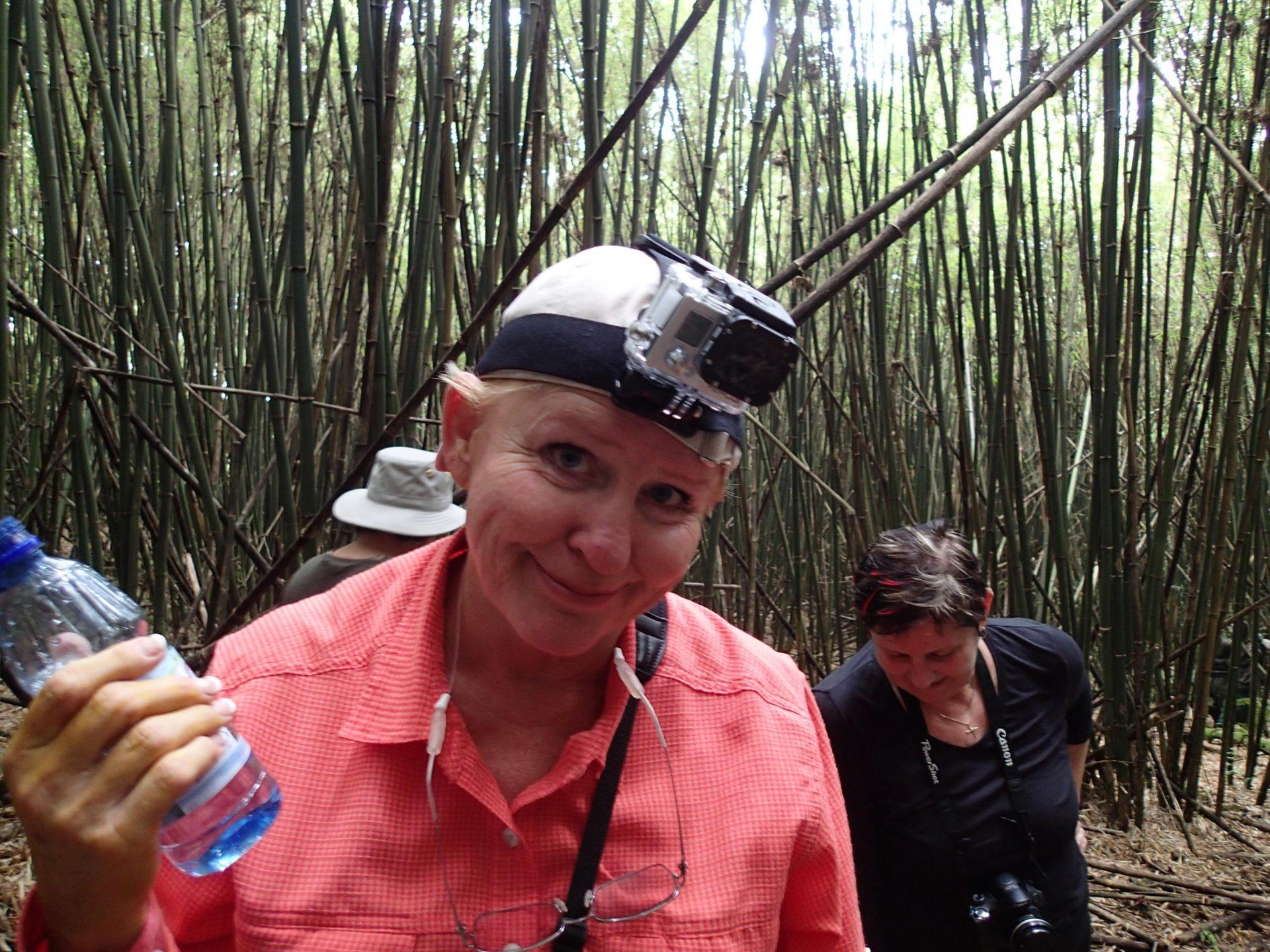 Sandi with a small camera, a Go Pro on her head and her trusty Nikon.  Following gorillas in Rwanda.