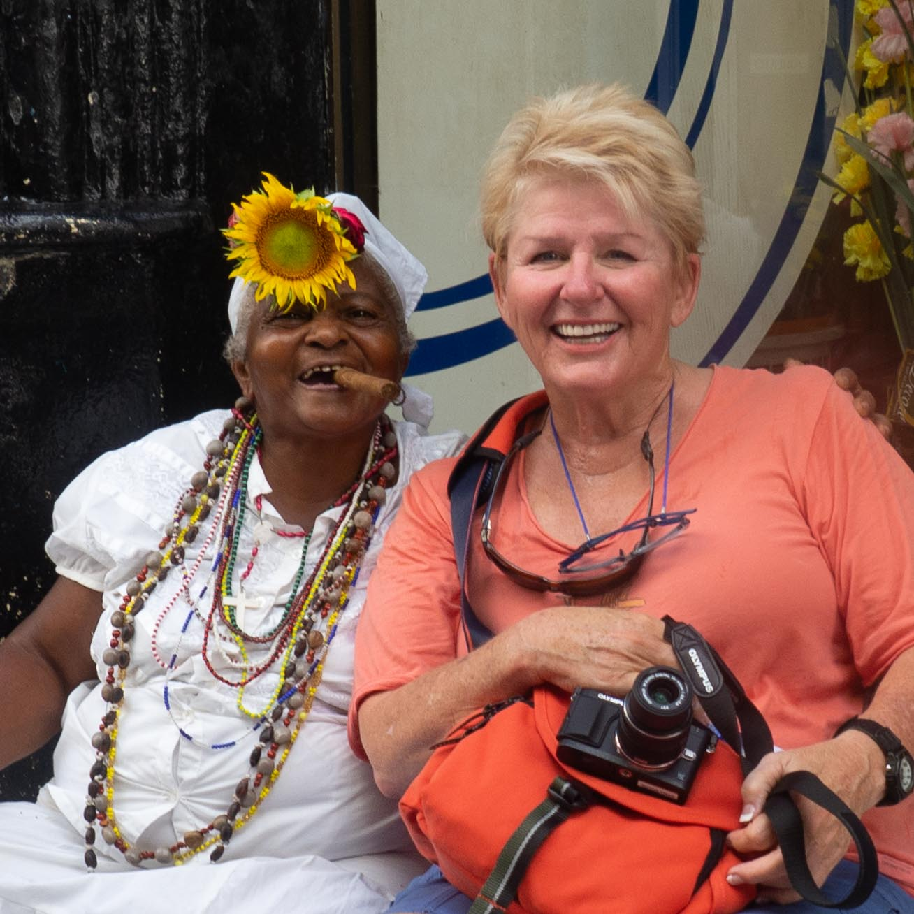 In Old Havana Cuba with a cigar lady.  You pay for your picture.