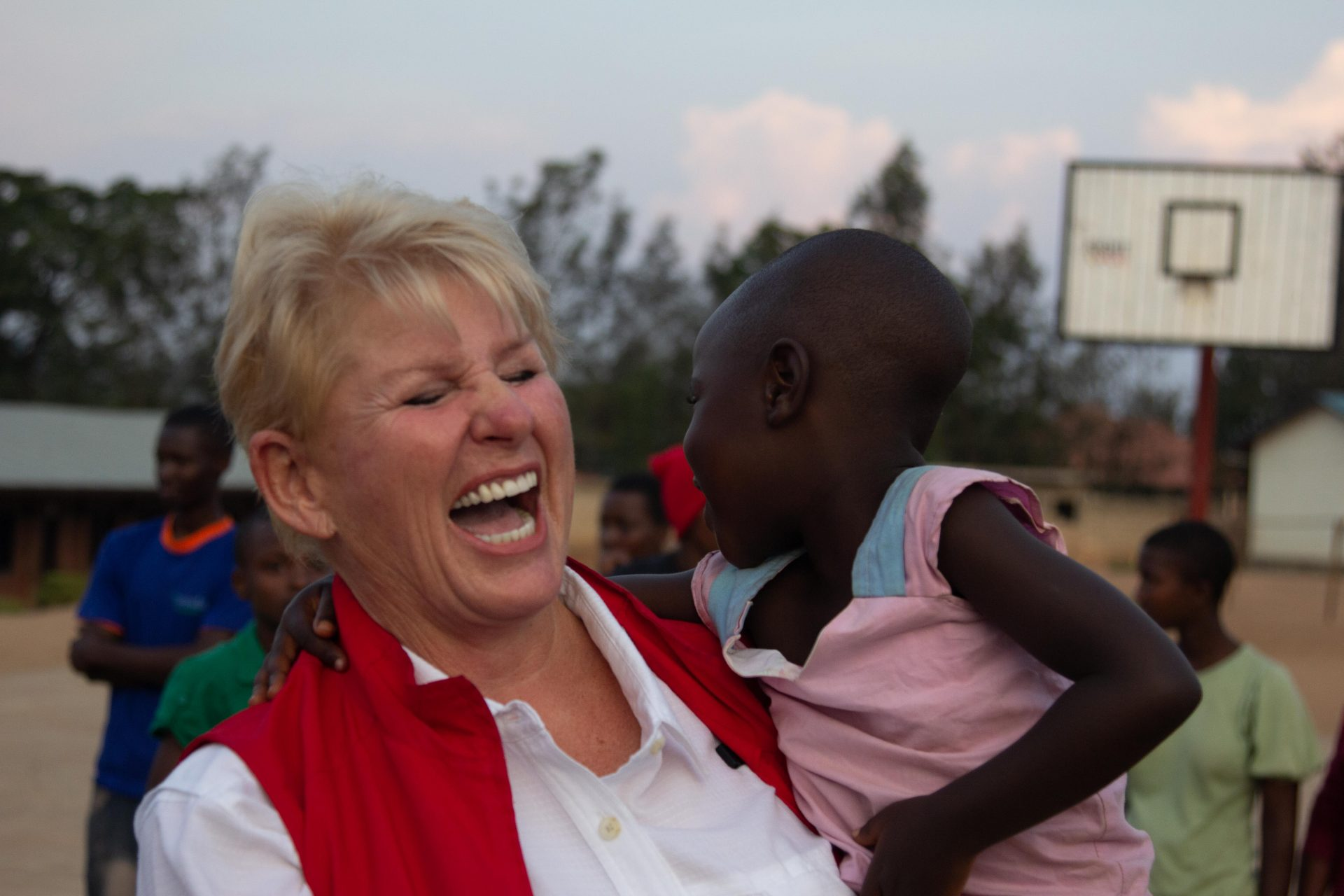 Doing charity work in Kigali, Rwanda with orphans.  We brought books, toys, clothes and danced with the kids.  Sandi had an absolute ball.