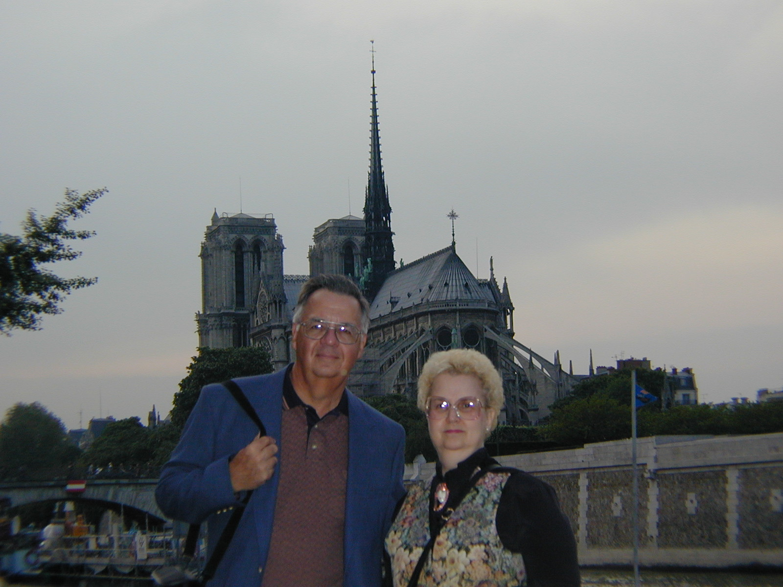 Tom and Ann in Paris with Notre Dame in the background (2000)