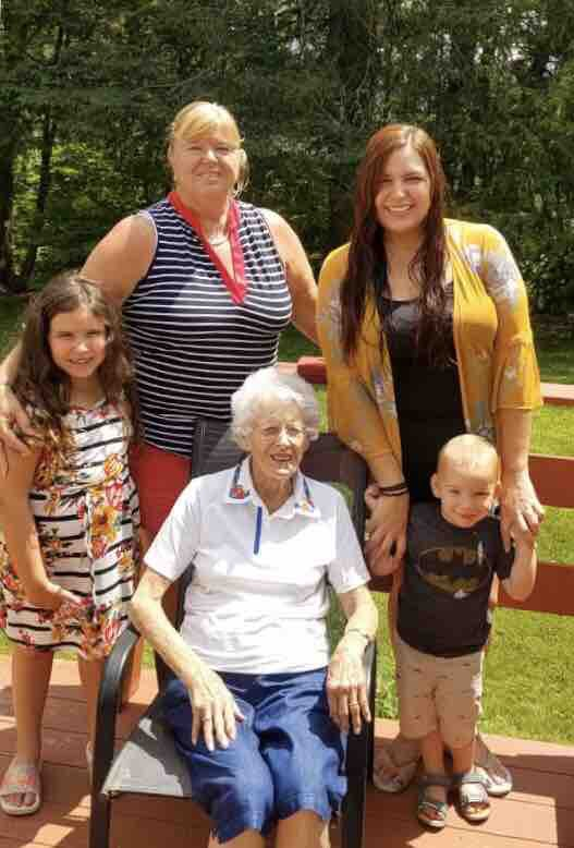 Four generations at China Lake in Maine.  Sue with her mom, daughter Jo, and grandchildren Raina and Ryder