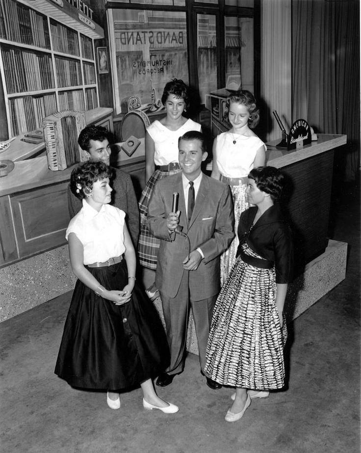 Barbara on American Bandstand standing behind Dick Clark.
