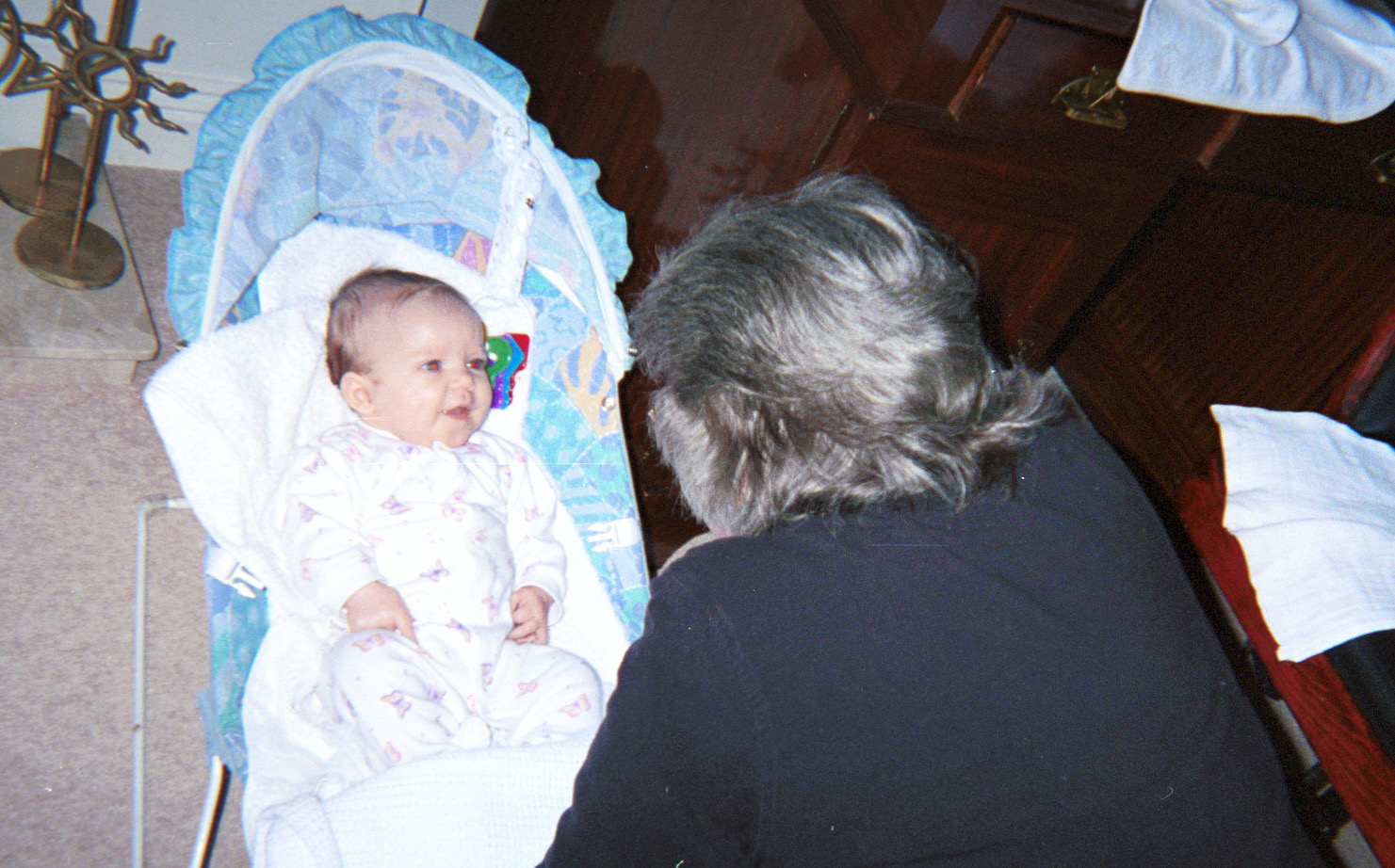 Grandma Mary Lou on first visit to meet first grandchild, Natalie. UK December 2000