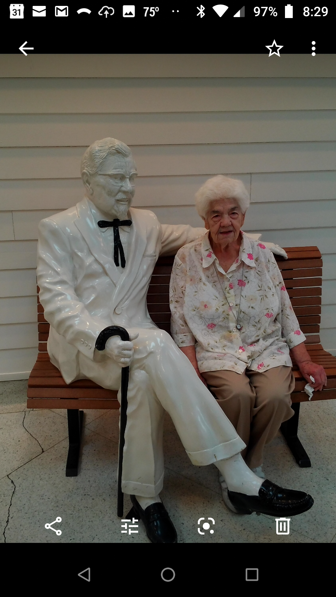 Mom with Colonel Sanders on trip to Kentucky