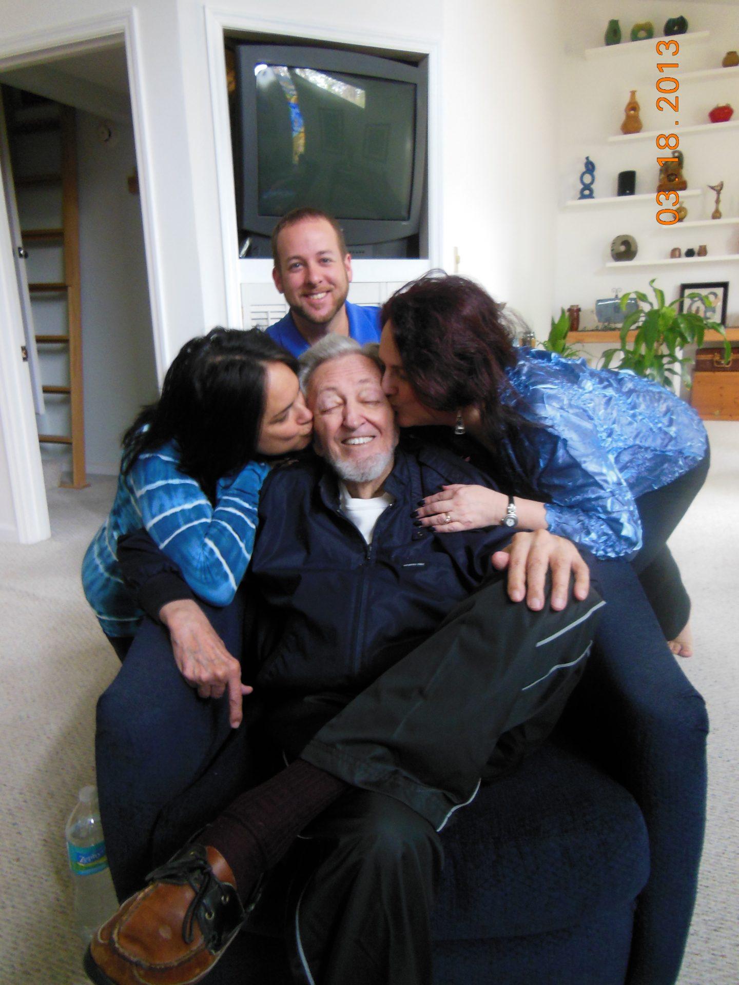 Bonnie and Robin kissing Dad. Josh behind dad. March 2013