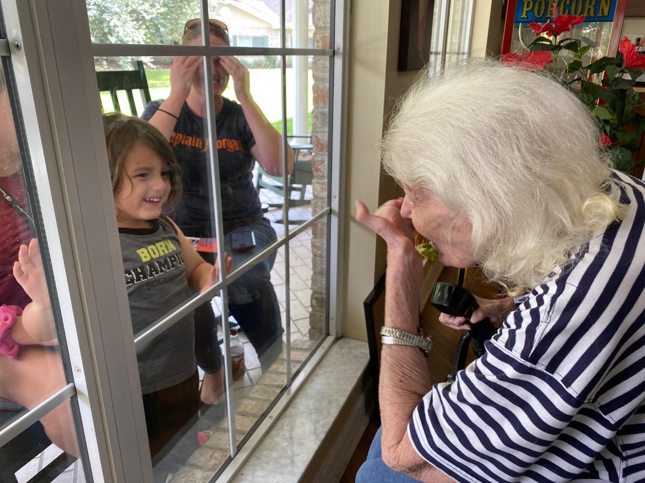 Grandma blowing Micco kisses