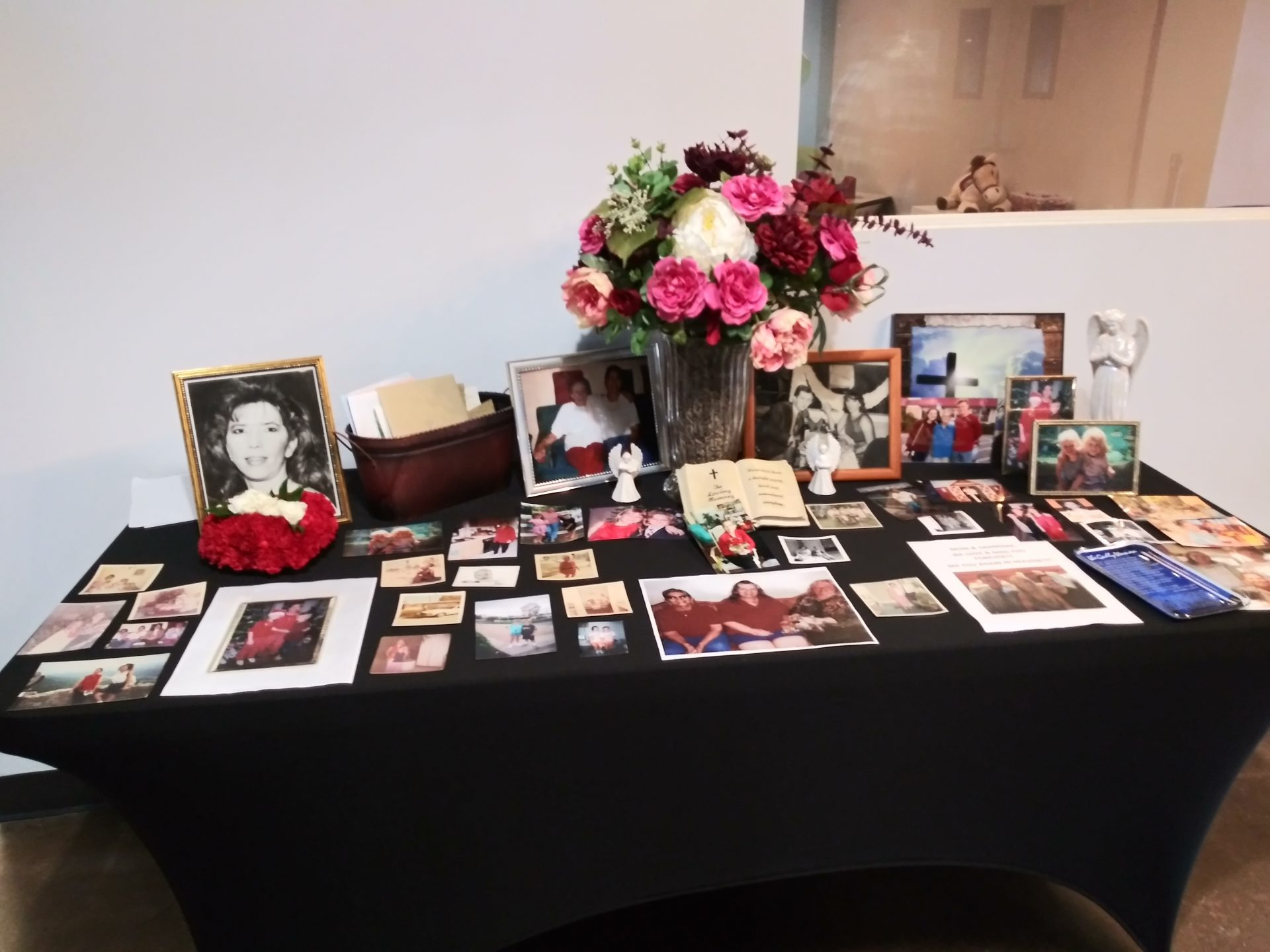 Table of Pictures of Evelyn's Life, Family and Friends at Memorial.