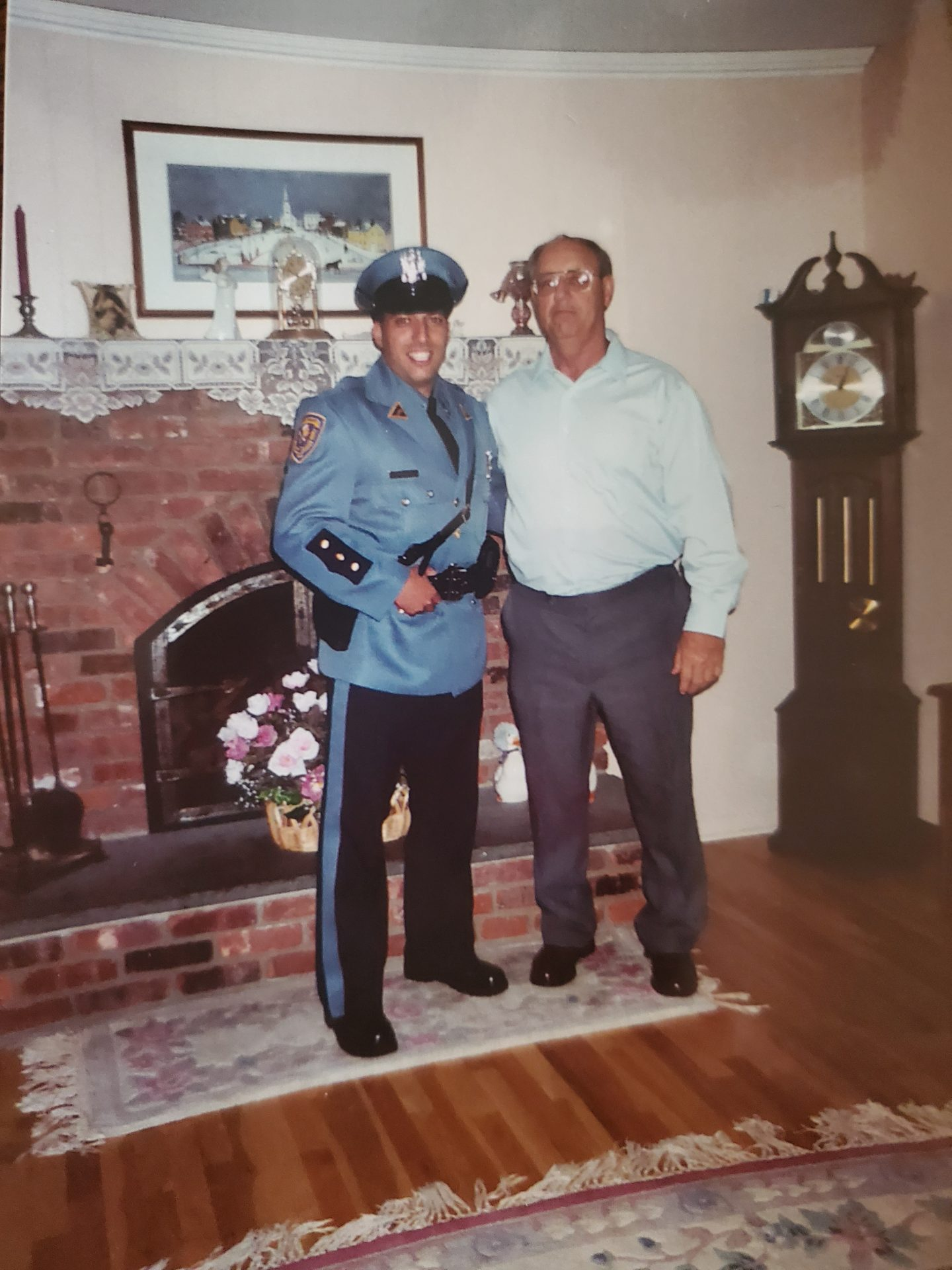 Me and my Godfather after I graduated from the police academy.