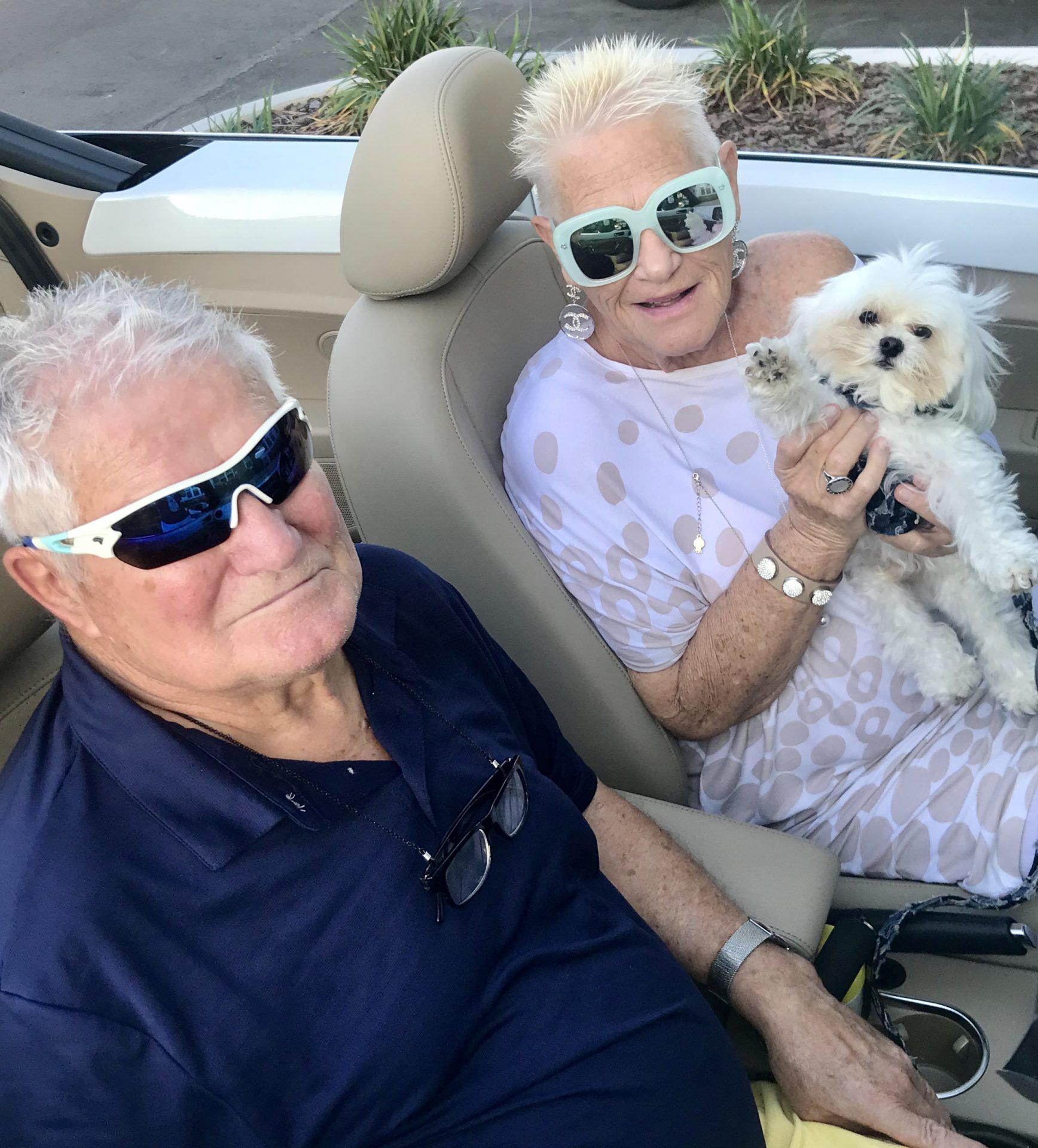 Gloria & Charlie in her VW convertible (and grand puppy Tinley)
