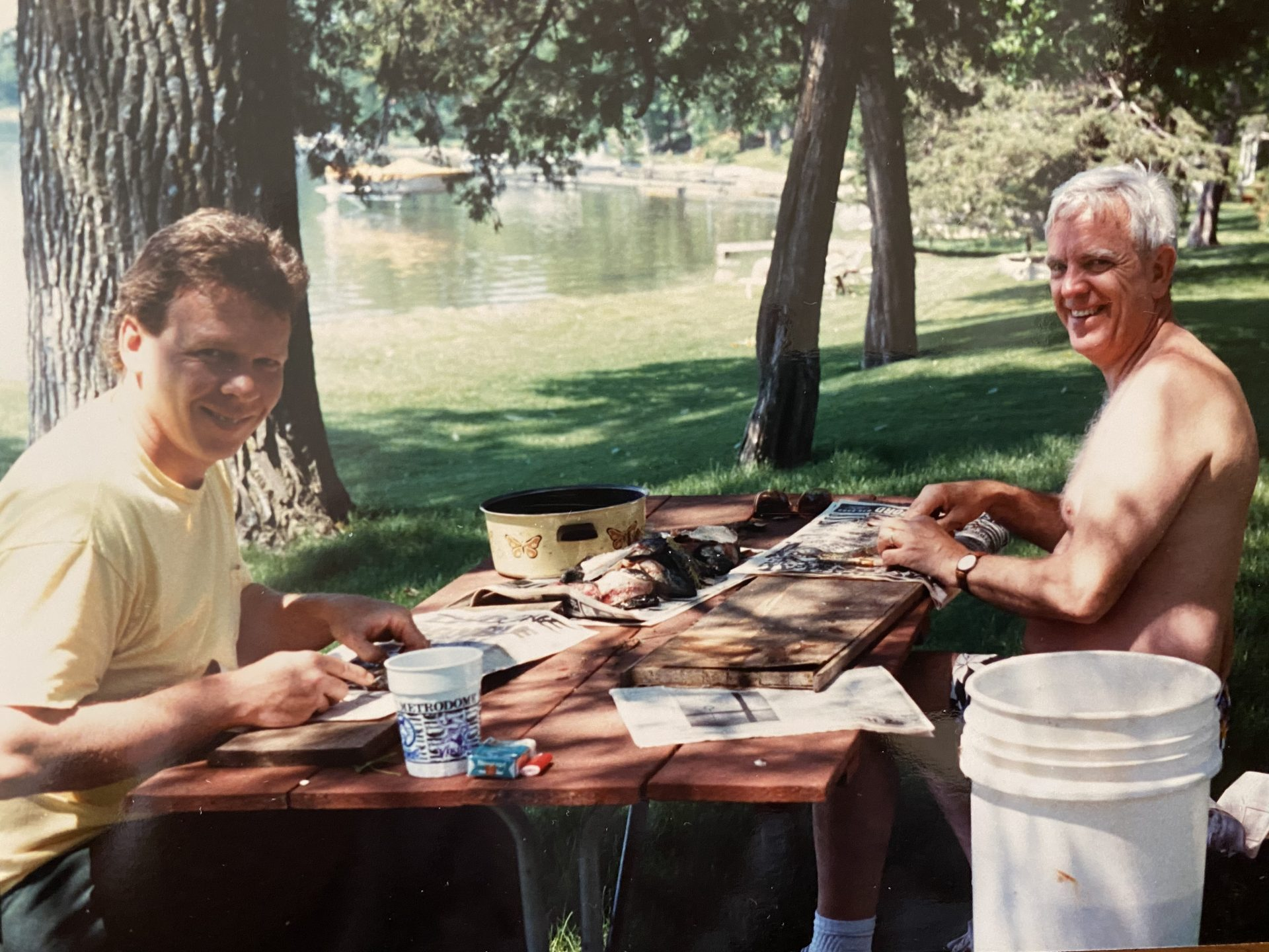 Dad and Jim cleaning fish after a good day of fishing on the lake in Minnesota.
