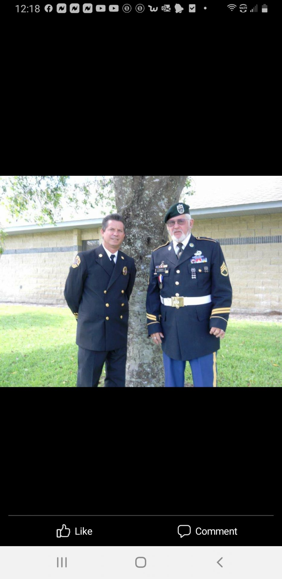 Dad and I in uniform.